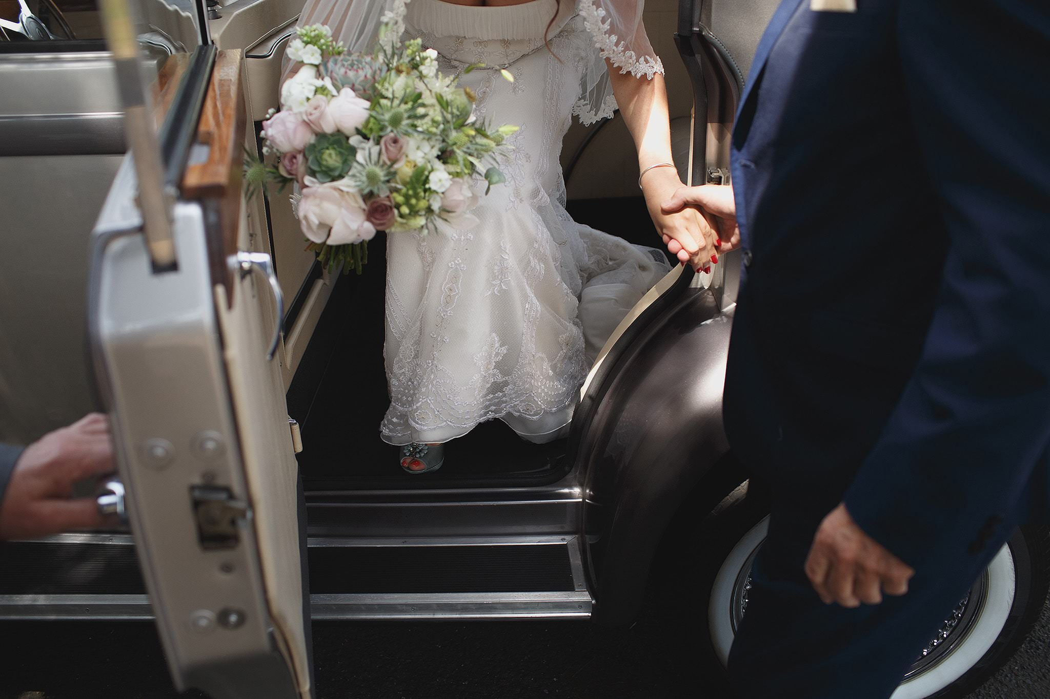 Creative picture of the bride arriving by Browsholme Hall Wedding Photographer Toni Darcy.