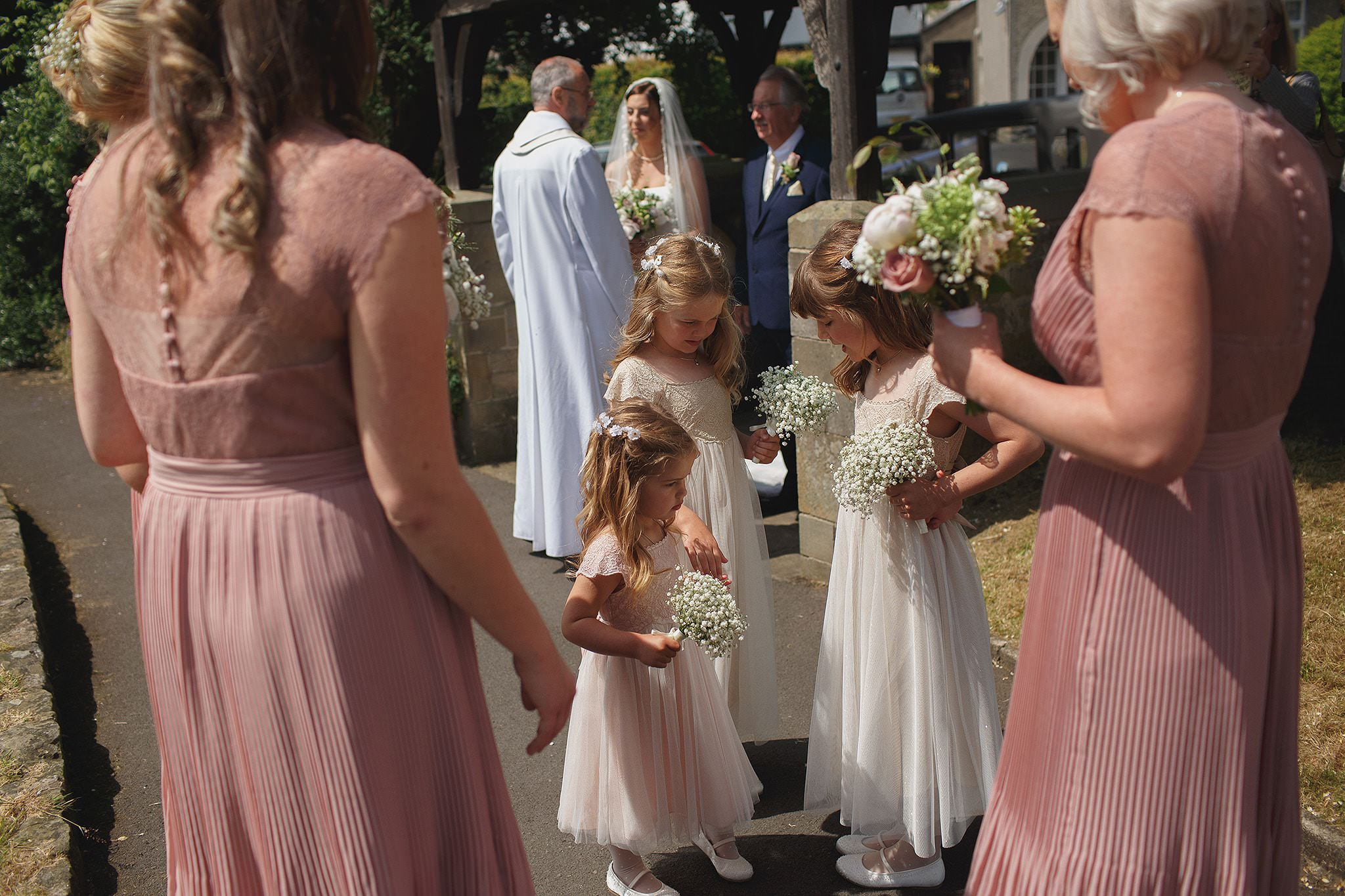 Bride and bridesmaids arriving at Browsholme Hall wedding.