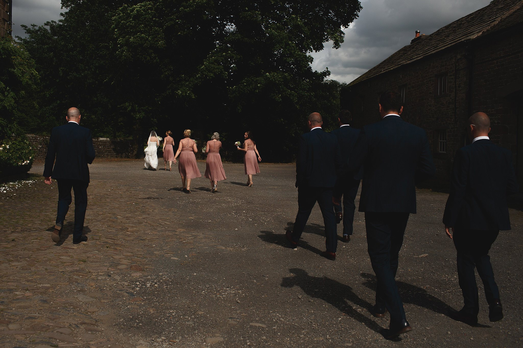 The bridal party walking by Browsholme Hall Wedding Photographer Toni Darcy.