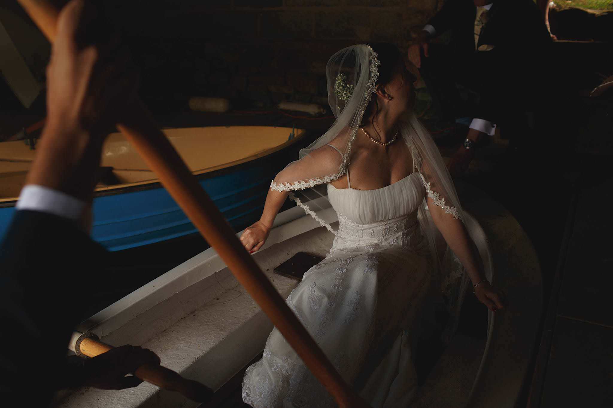 Bride in rowing boat at Browsholme Hall Wedding by Lancashire wedding photographer Toni Darcy.
