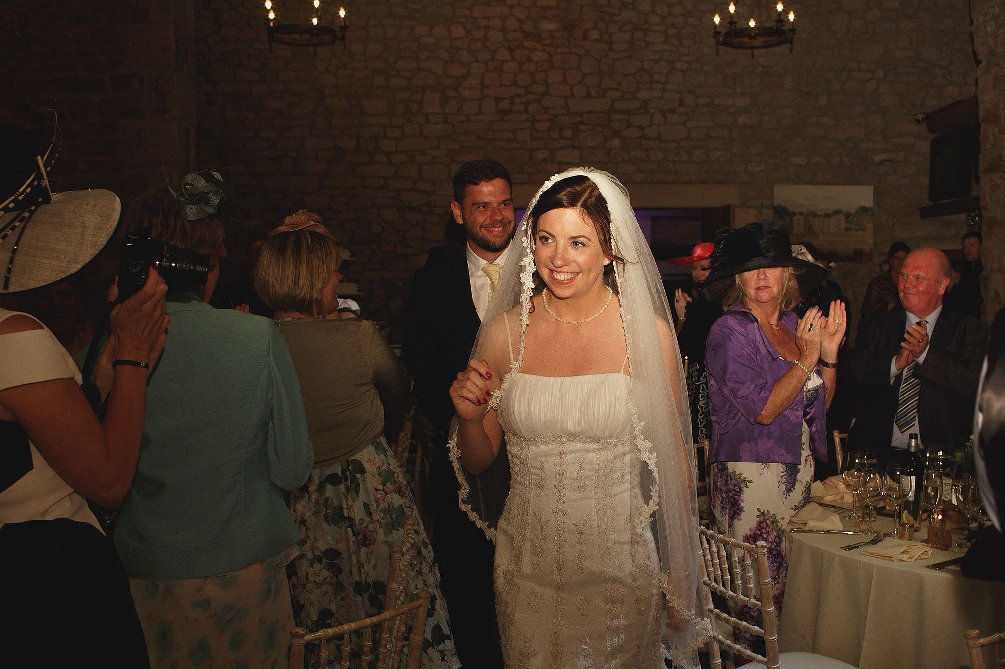 Bride and Groom entering wedding reception at Browsholme Hall Wedding.