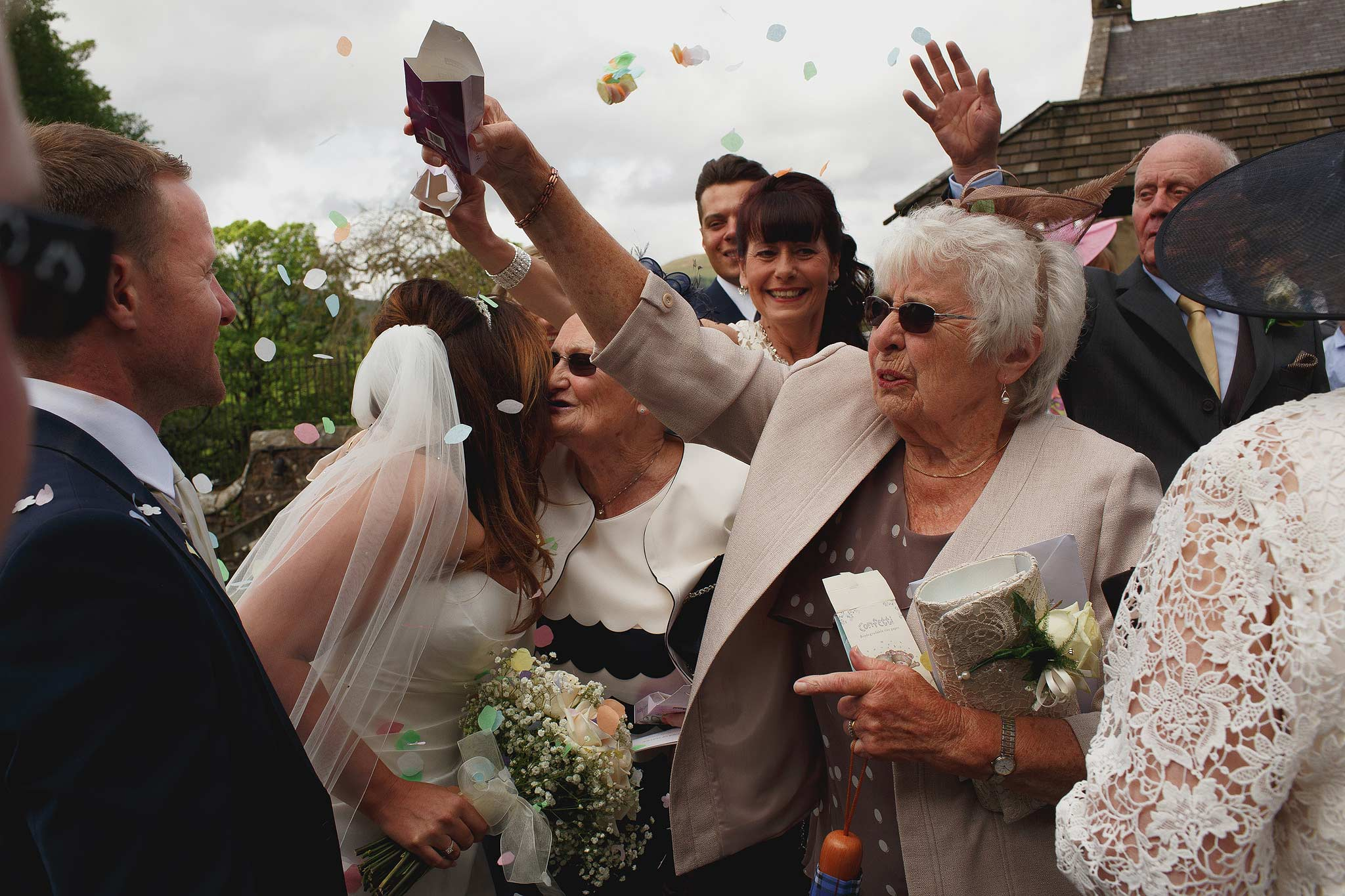 Confetti being thrown at a wedding at the inn at whitewell
