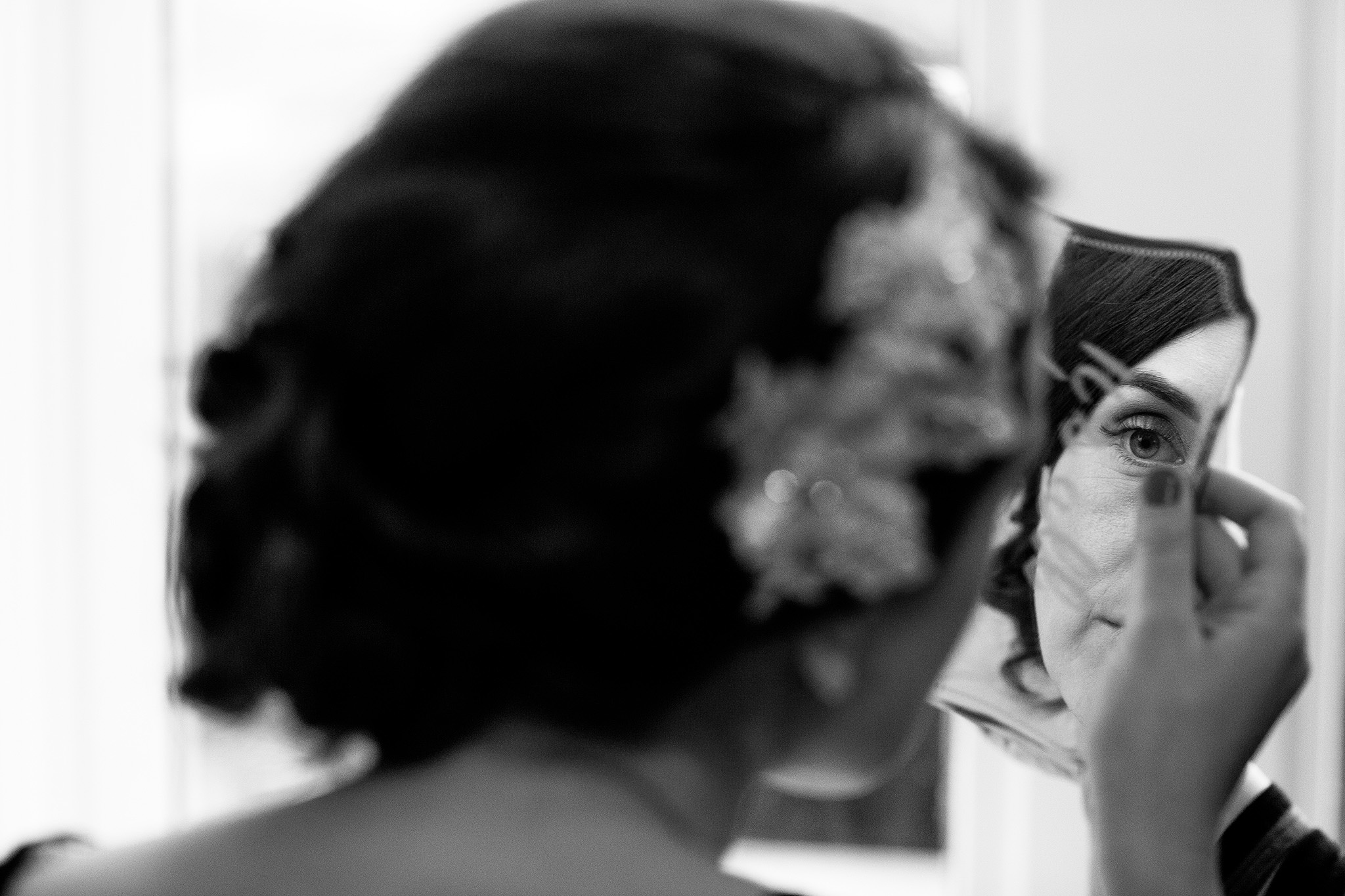 Creative image of a bride having her make up.