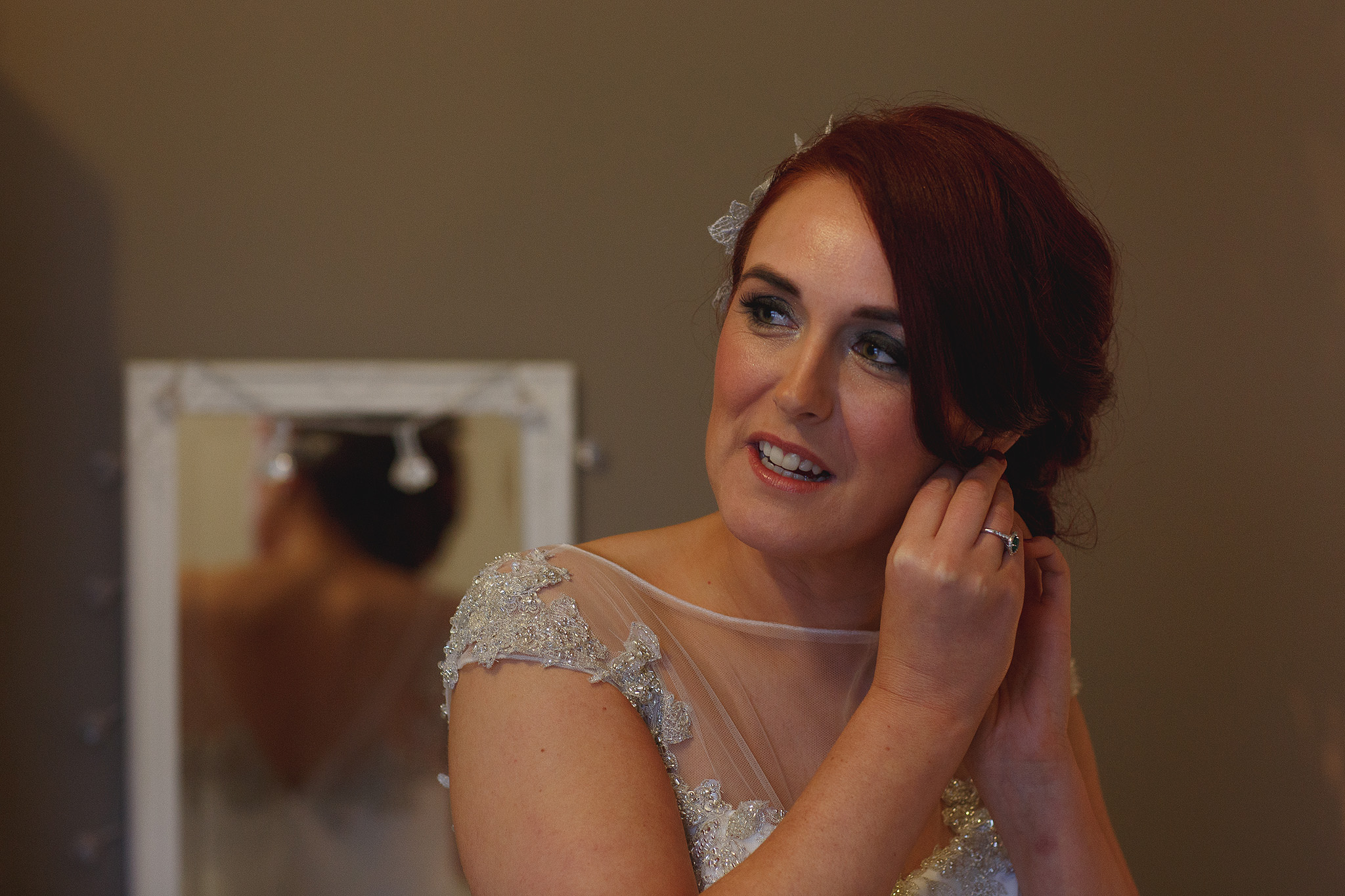 Bride applying finishing touches for wedding at Browsholme Barn.