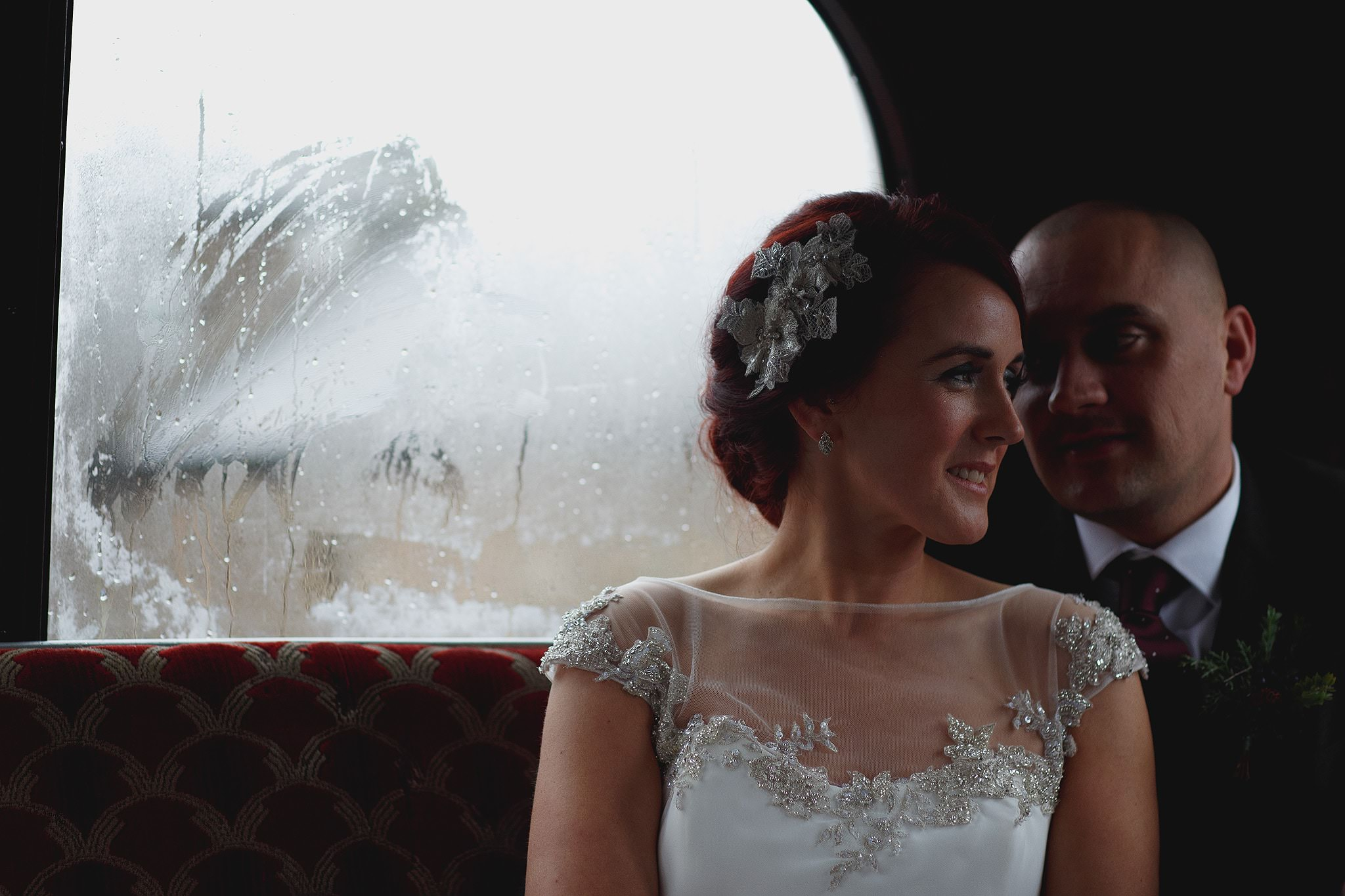 Bride and Groom on a vintage wedding bus at Browsholme Barn.