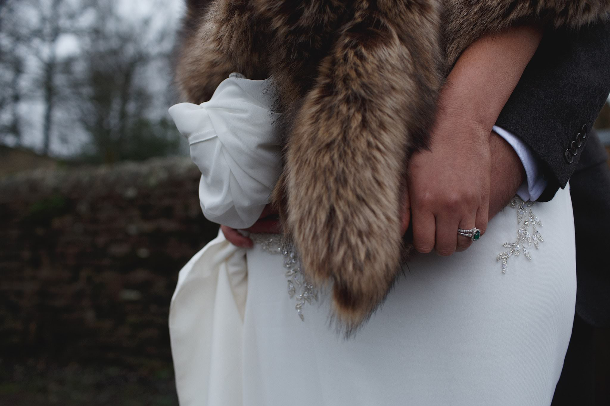 Bride style - a fur wrap and emerald engagement ring for wedding at Browsholme Barn.