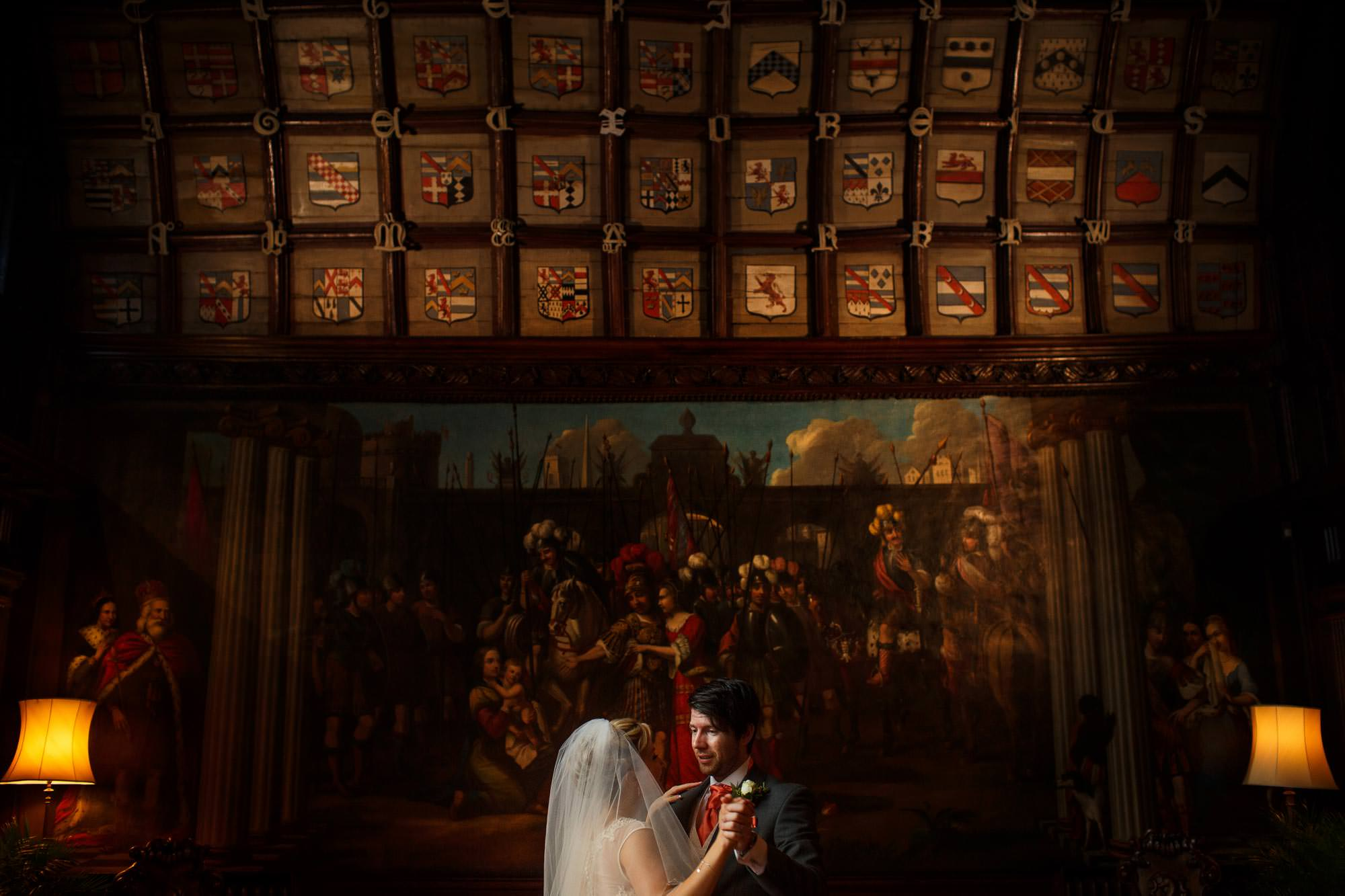 Bride and Groom dancing in the main hall with beautiful background at adlington hall and gardens