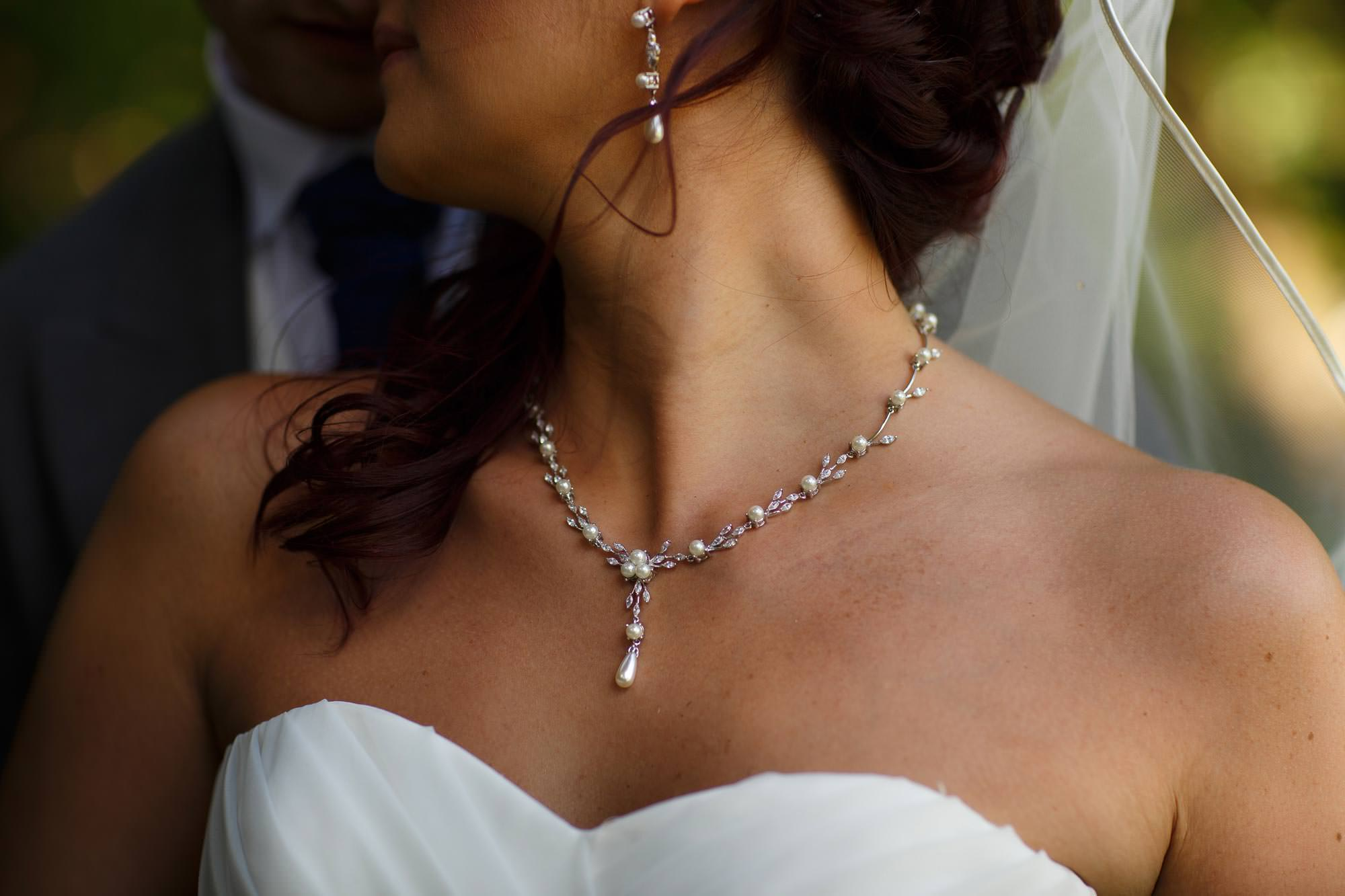 Close up detail of brides necklace at Arley Hall Wedding