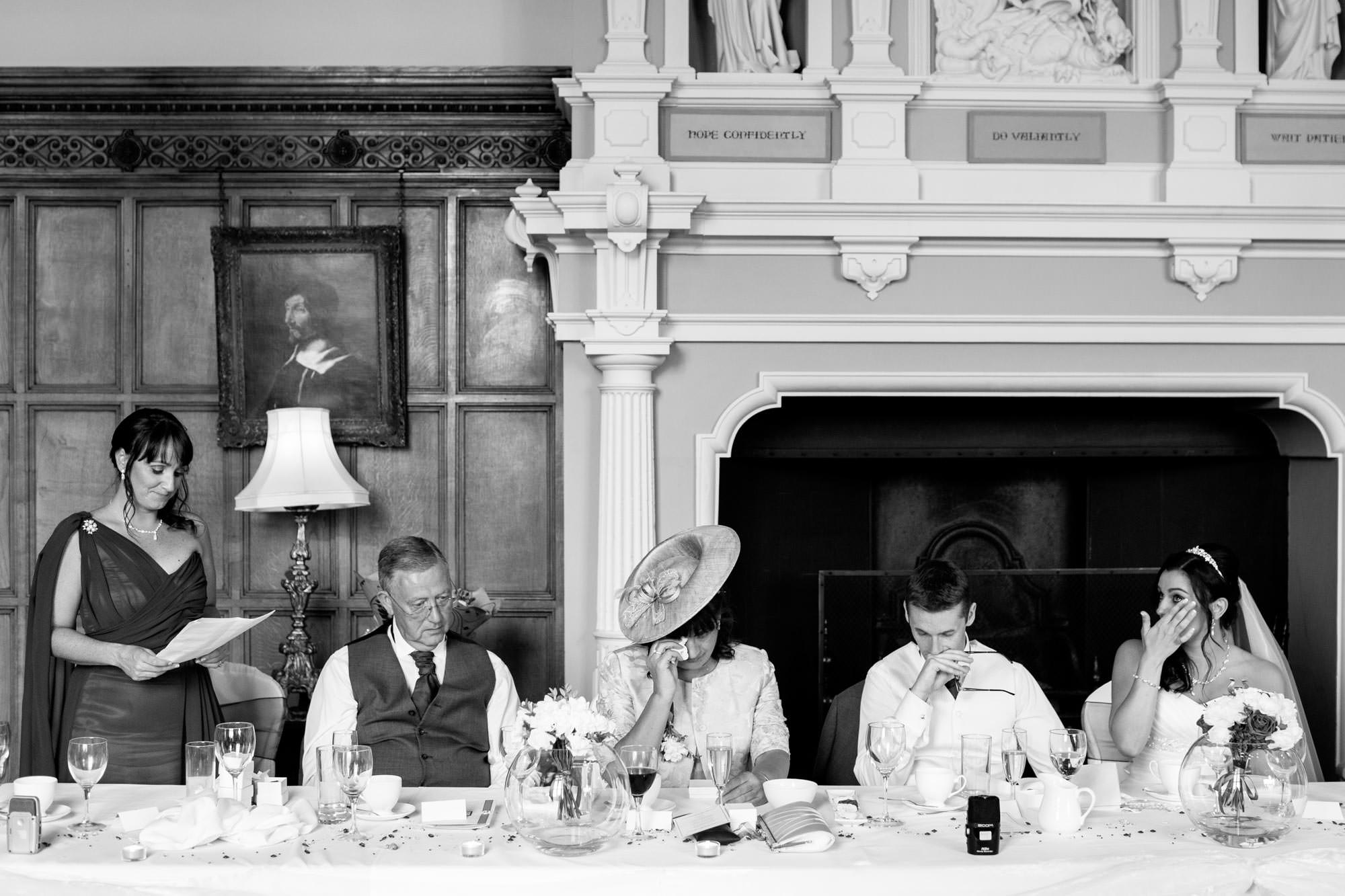 The top table all looking emotional during the speeches at Arley Hall wedding