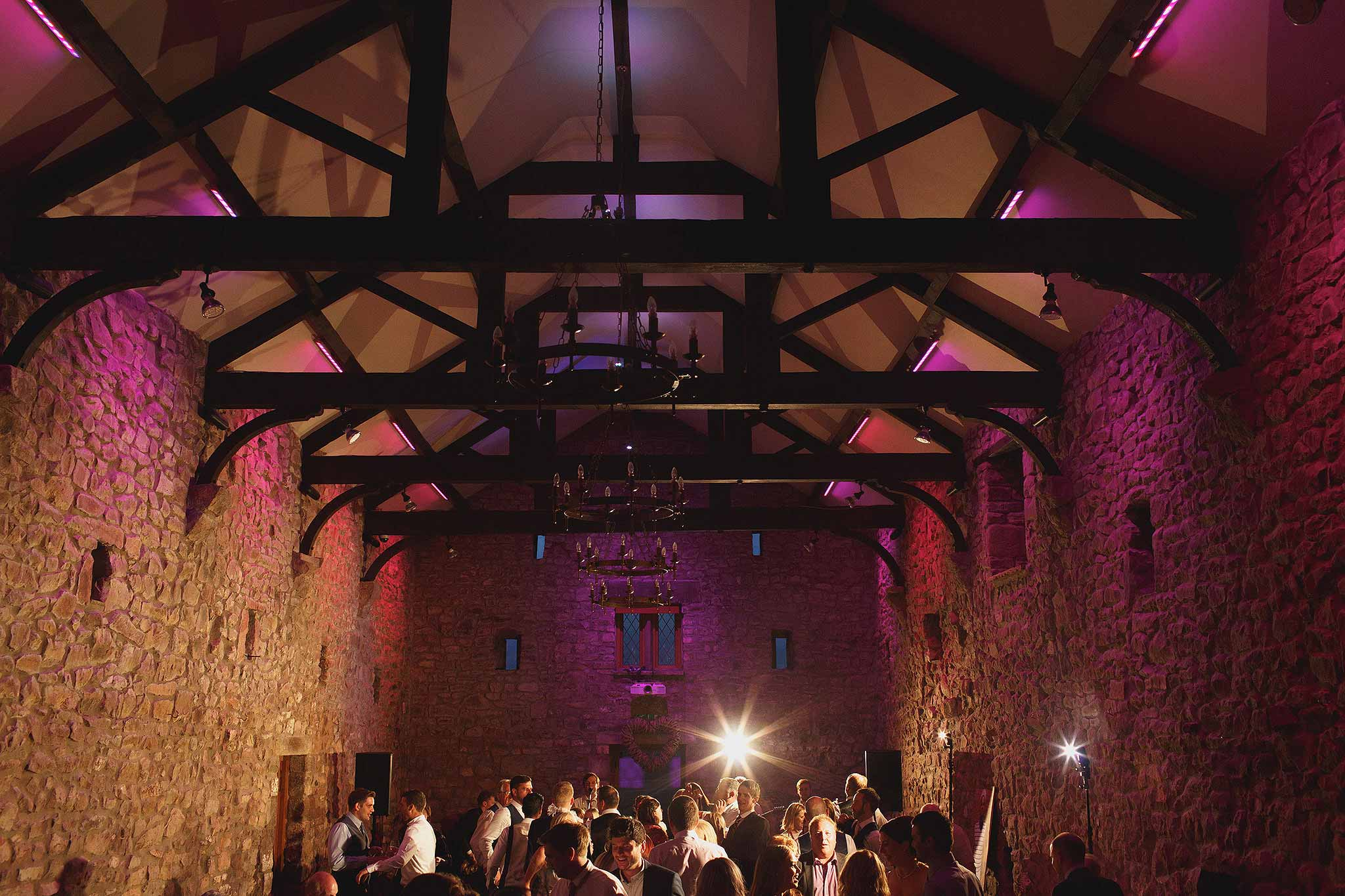 Browsholme Hall lit up inside at night for a wedding party