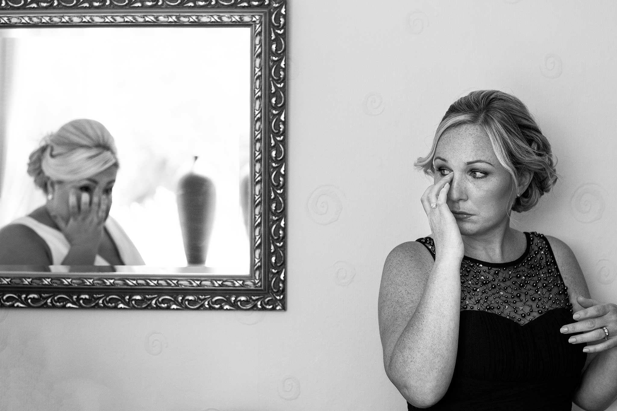 Reflection in a mirror or bridesmaid and bride both crying