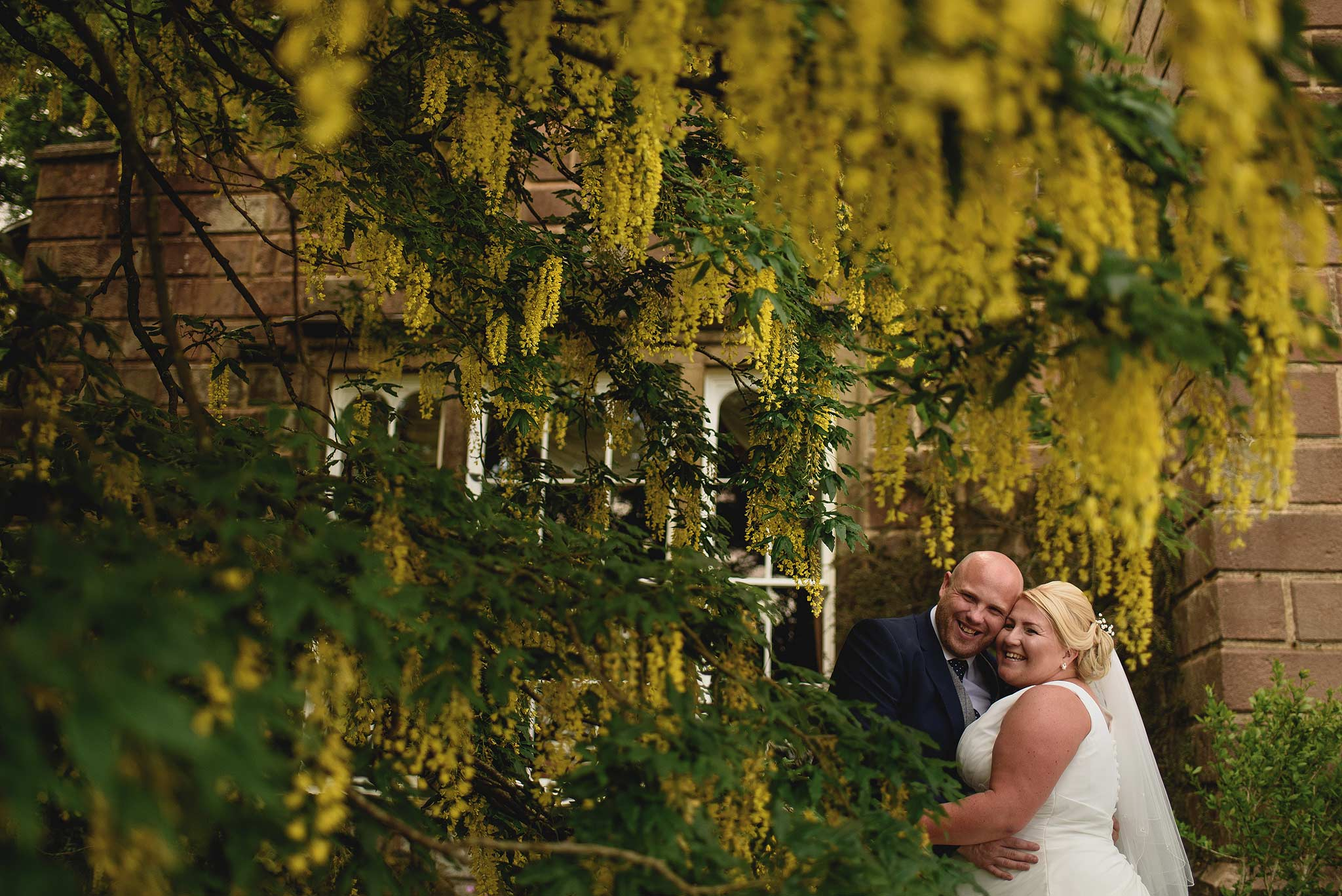 Bride and Groom under a yellow tree at Browsholme Hall