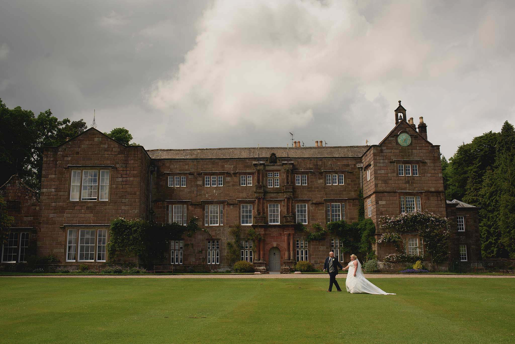 Bride and Groom walking outside at Browsholme Hall