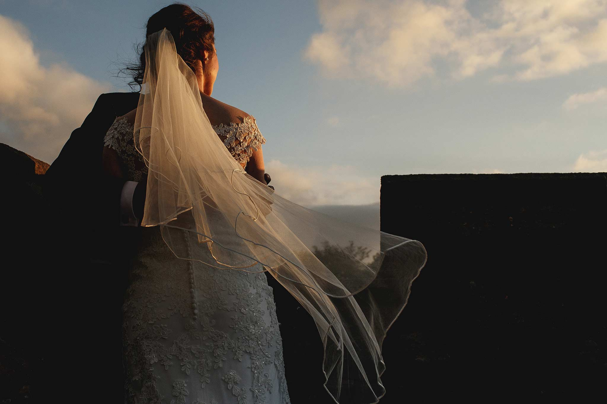Brides veil blowing during sunset at Hoghton Tower Wedding