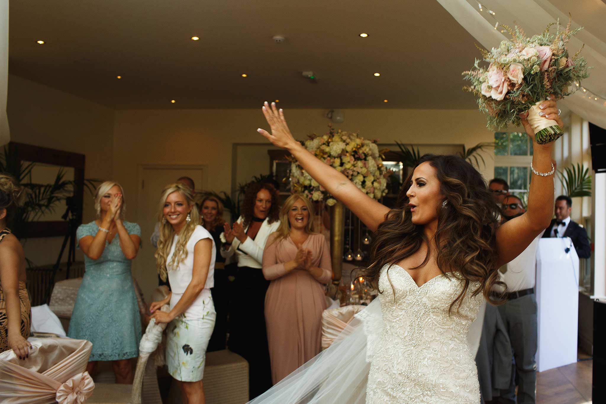 bride dancing in front of all the wedding quests at mitton hall
