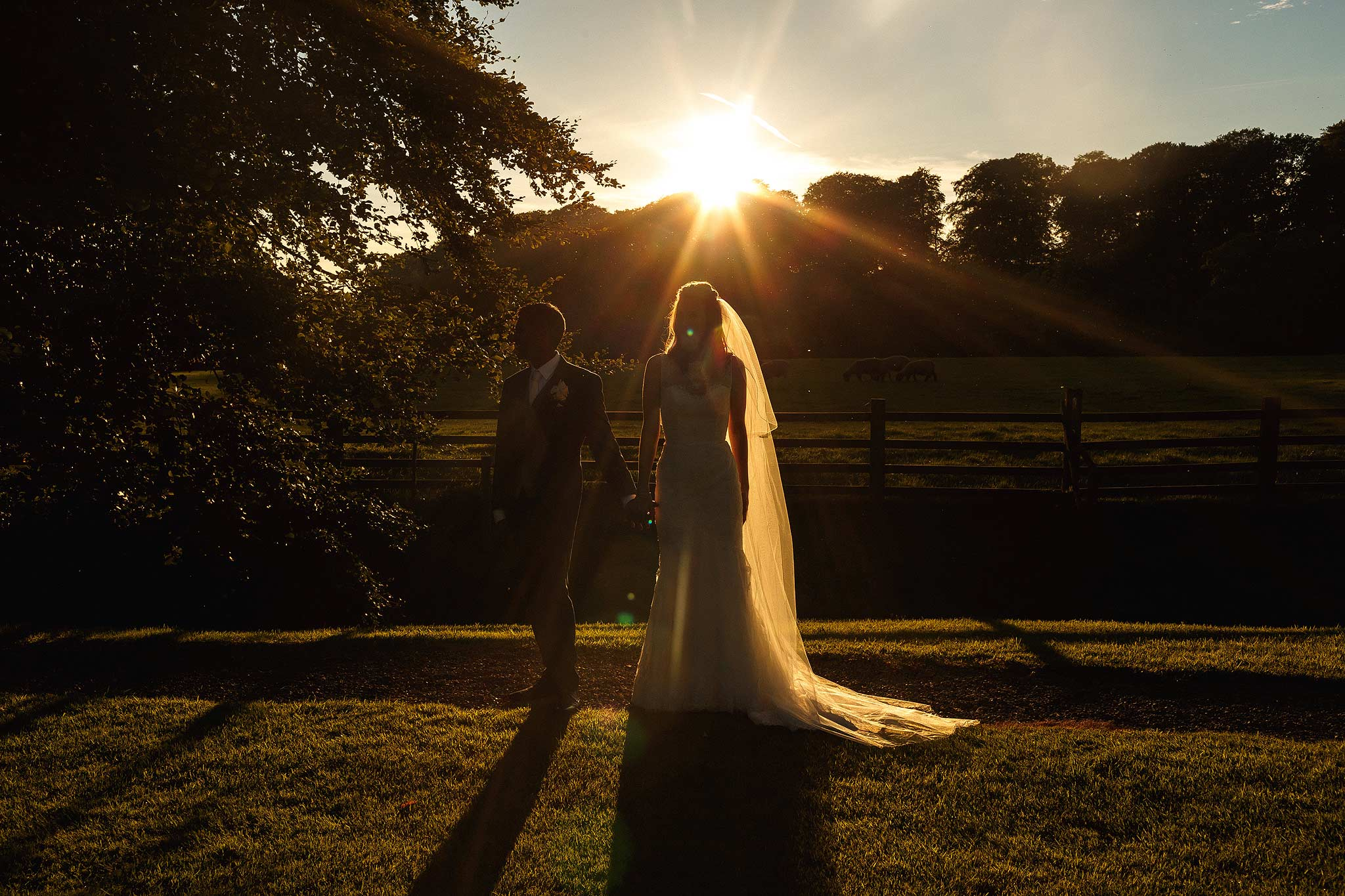 Bride and groom full length portrait outside at sunset at mitton hall