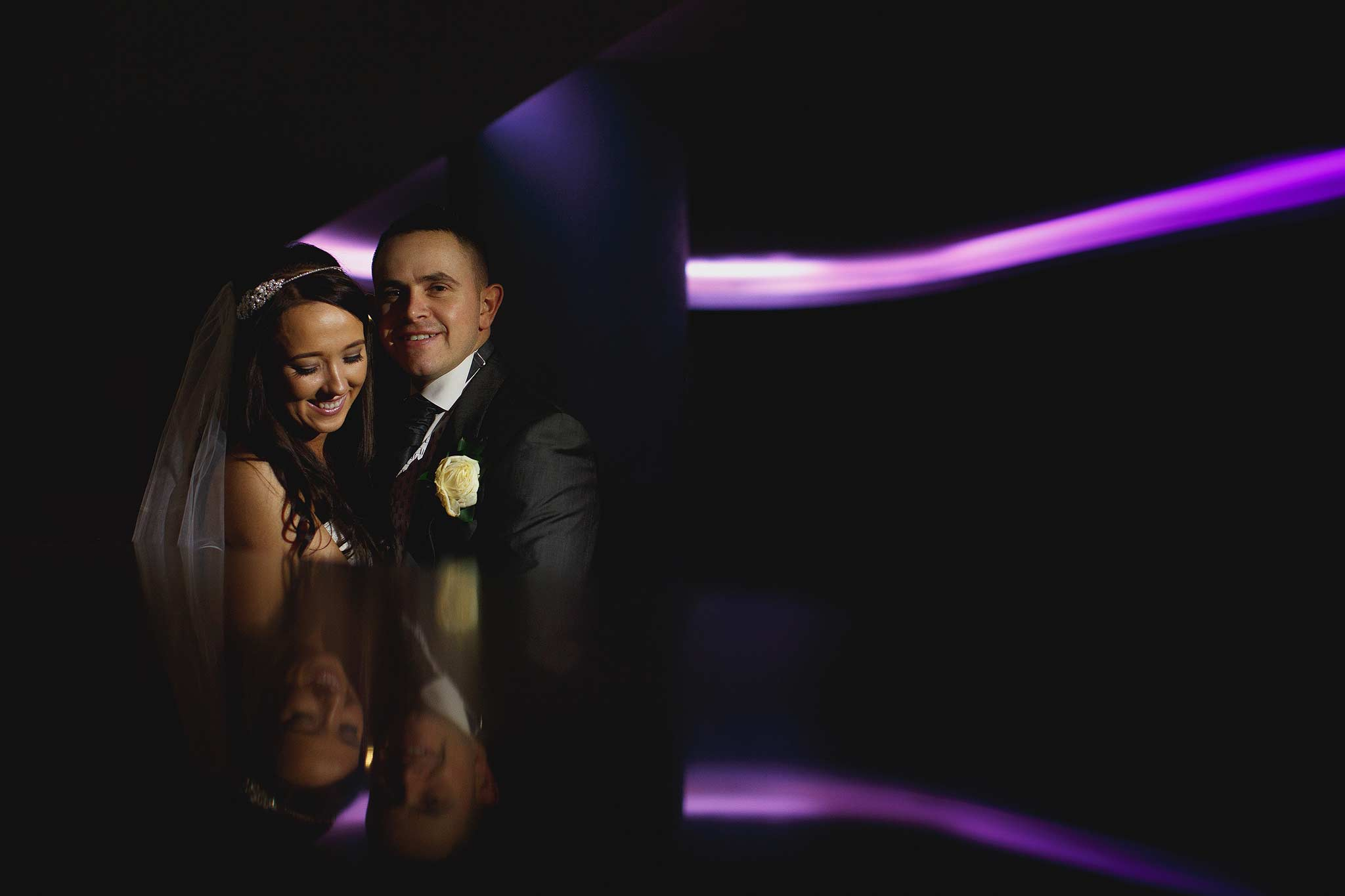 futuristic photograph of a bride and groom with neon lighting