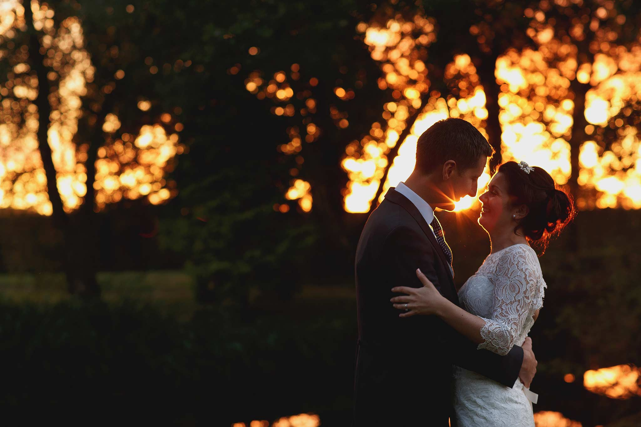 photograph of a bride and groom at sunset with nice bokeh at colshaw hall