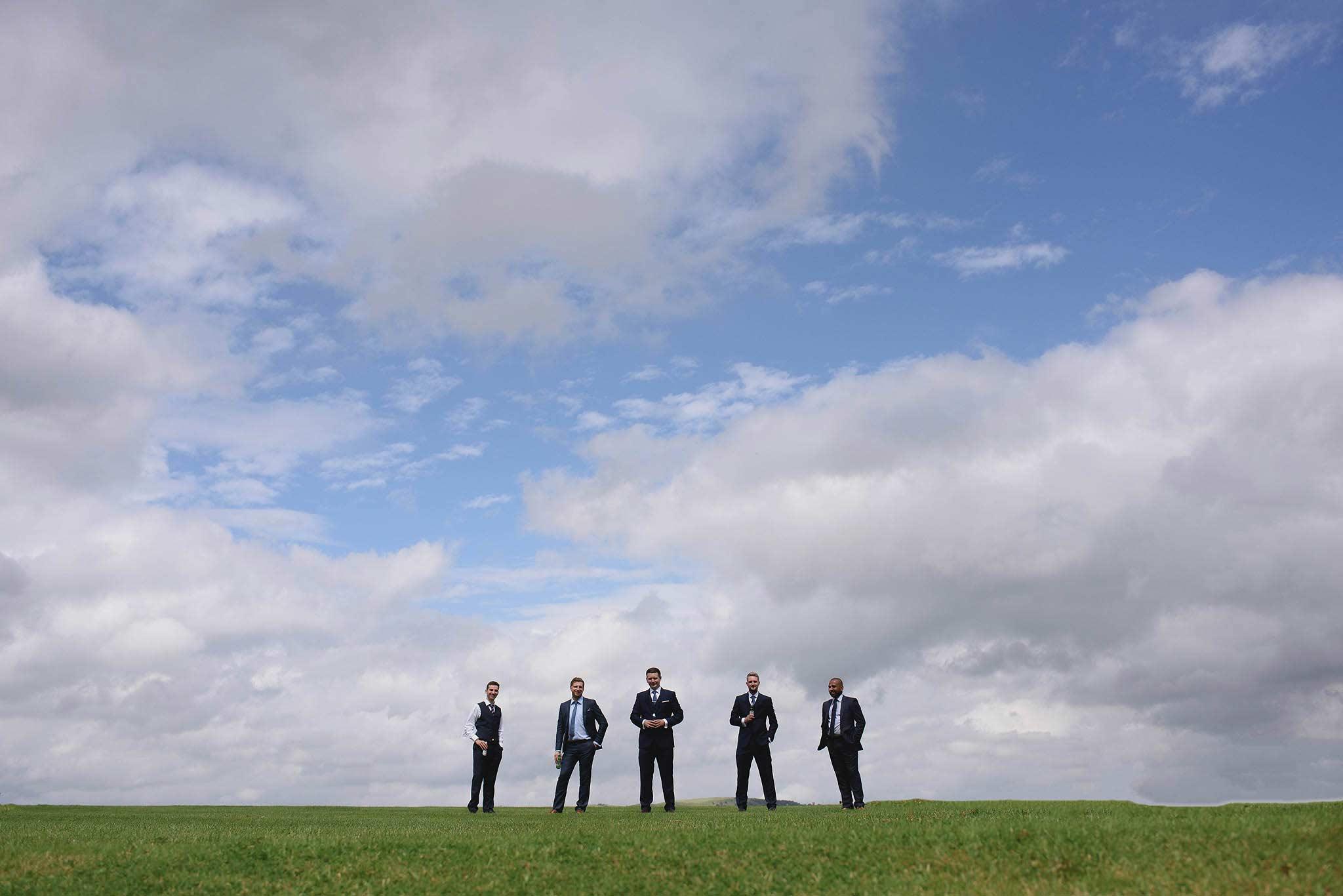 photograph of groomsmen outside Heaton House Farm