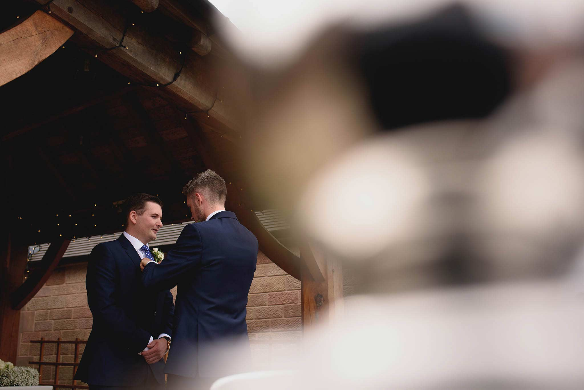documentary photograph of groomsmen just before wedding ceremony