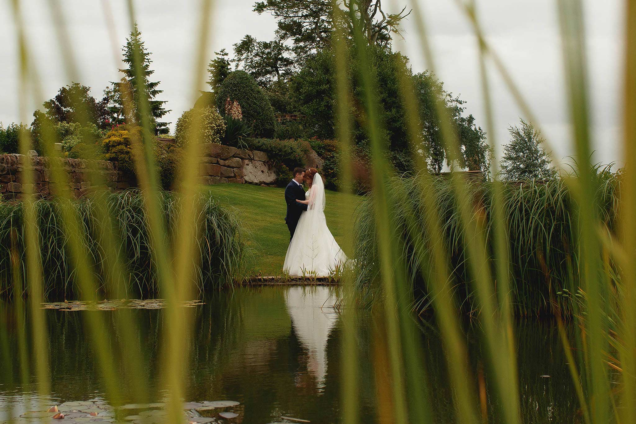romantic photograph of bride and groom at Heaton House Farm