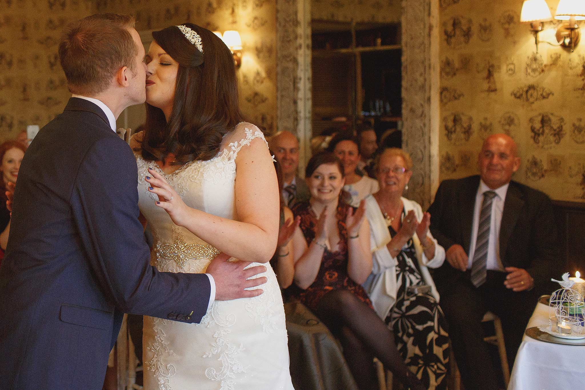bride and grooms first kiss at the shireburn arms