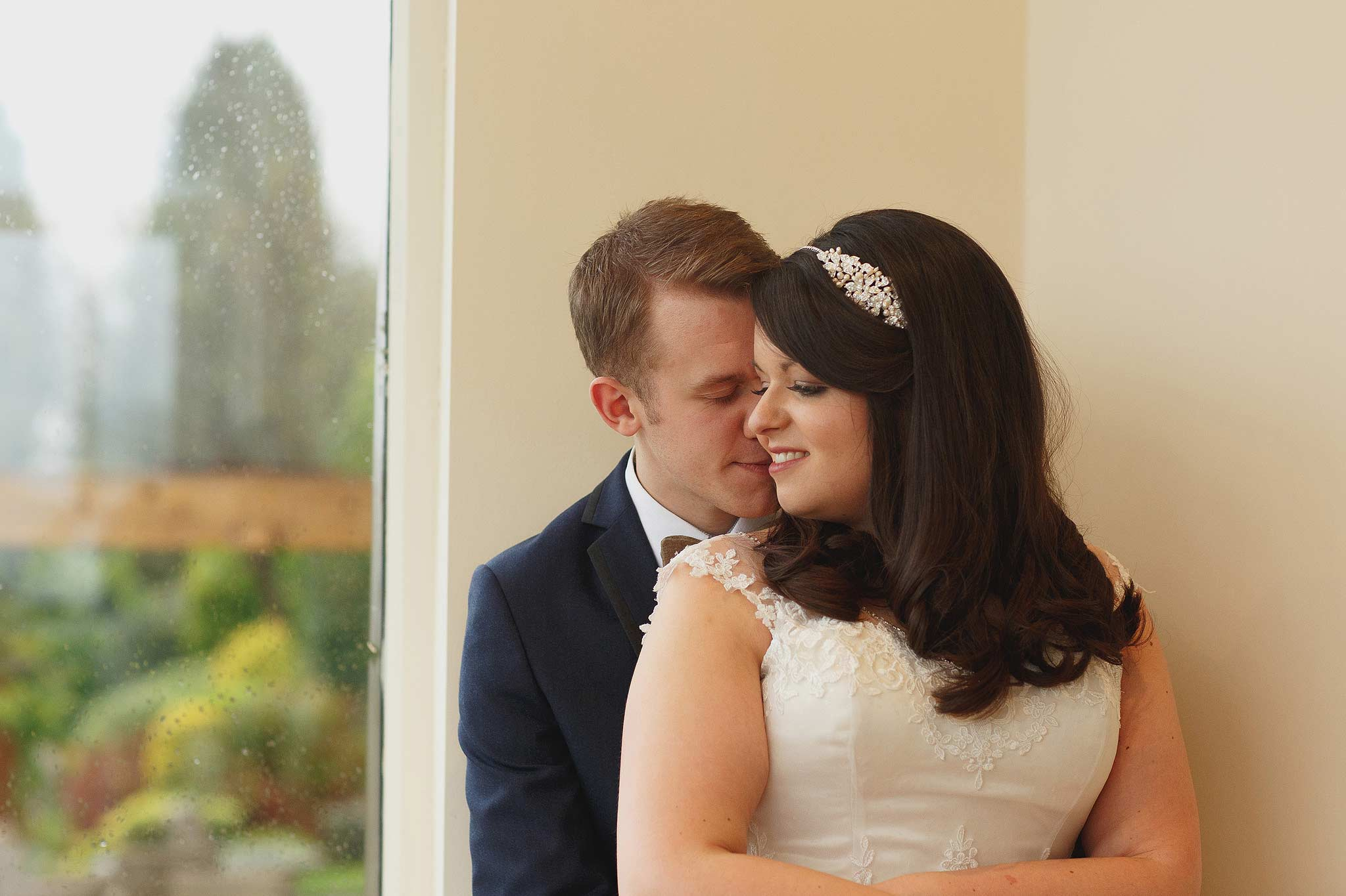 Clean indoor portrait of the bride and groom at the shireburn arms