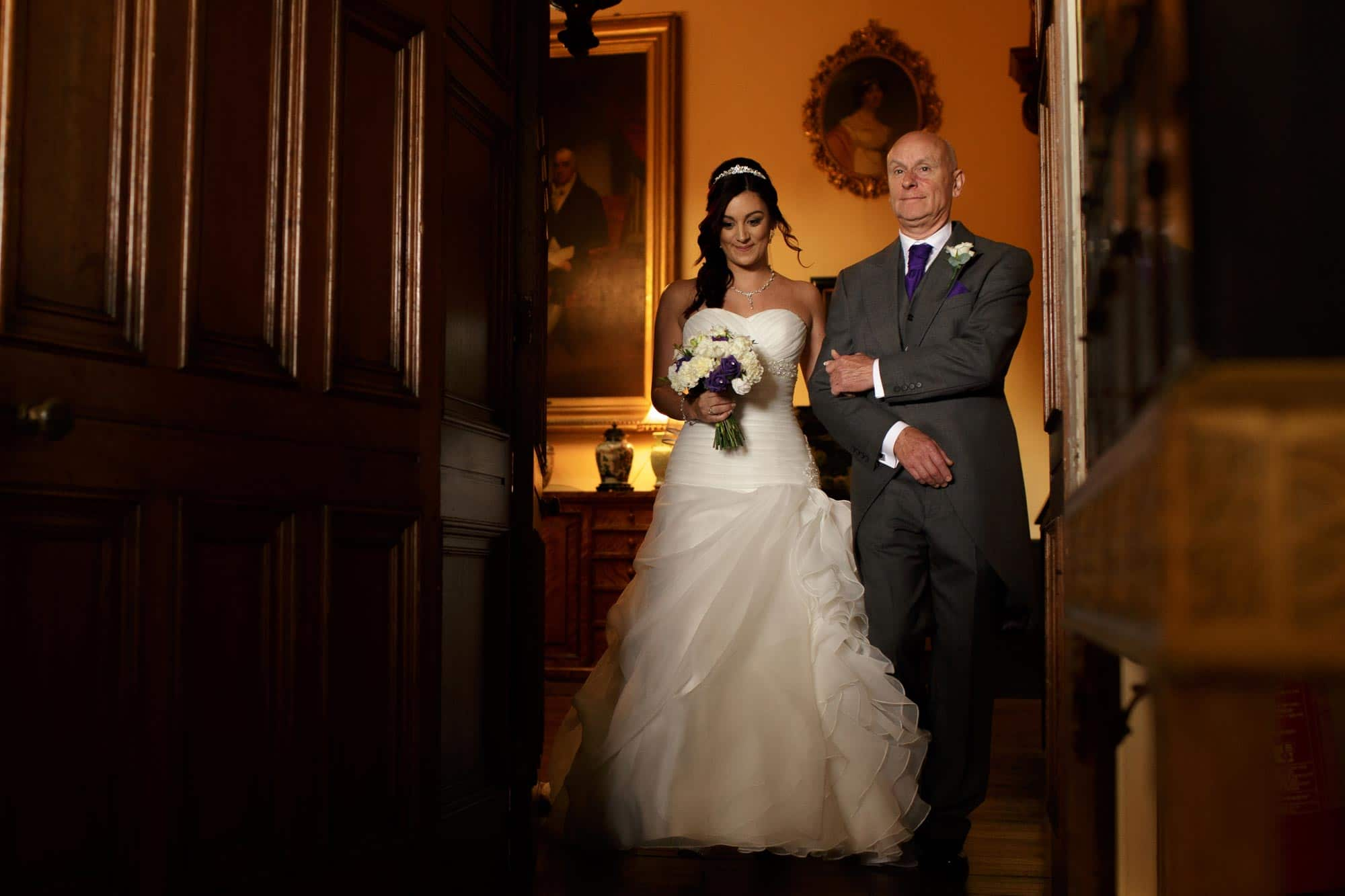 Father walking a bride down the aisle at Arley Hall wedding