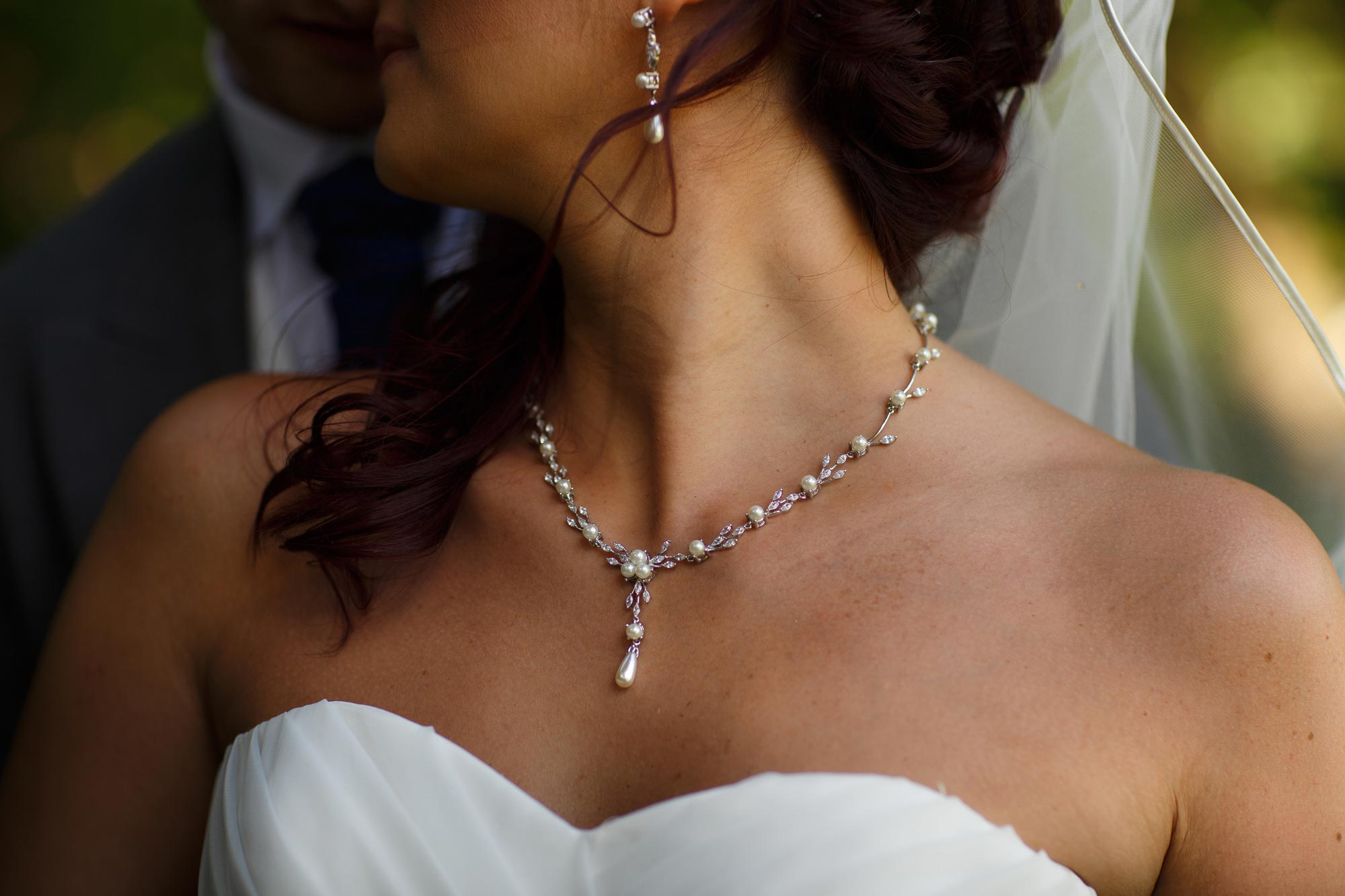 Close up photograph of brides necklace at Arley Hall Wedding