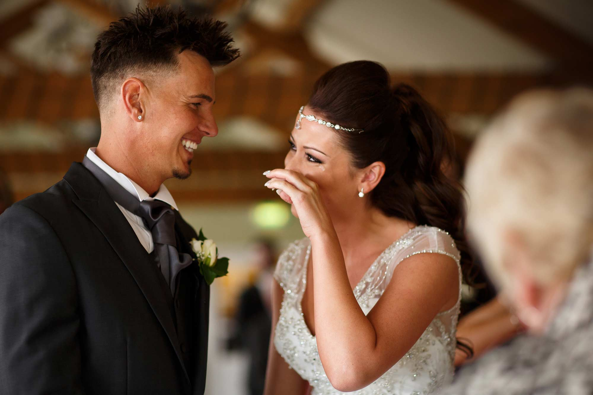 Emotional bride crying as she says her vows at alma inn wedding