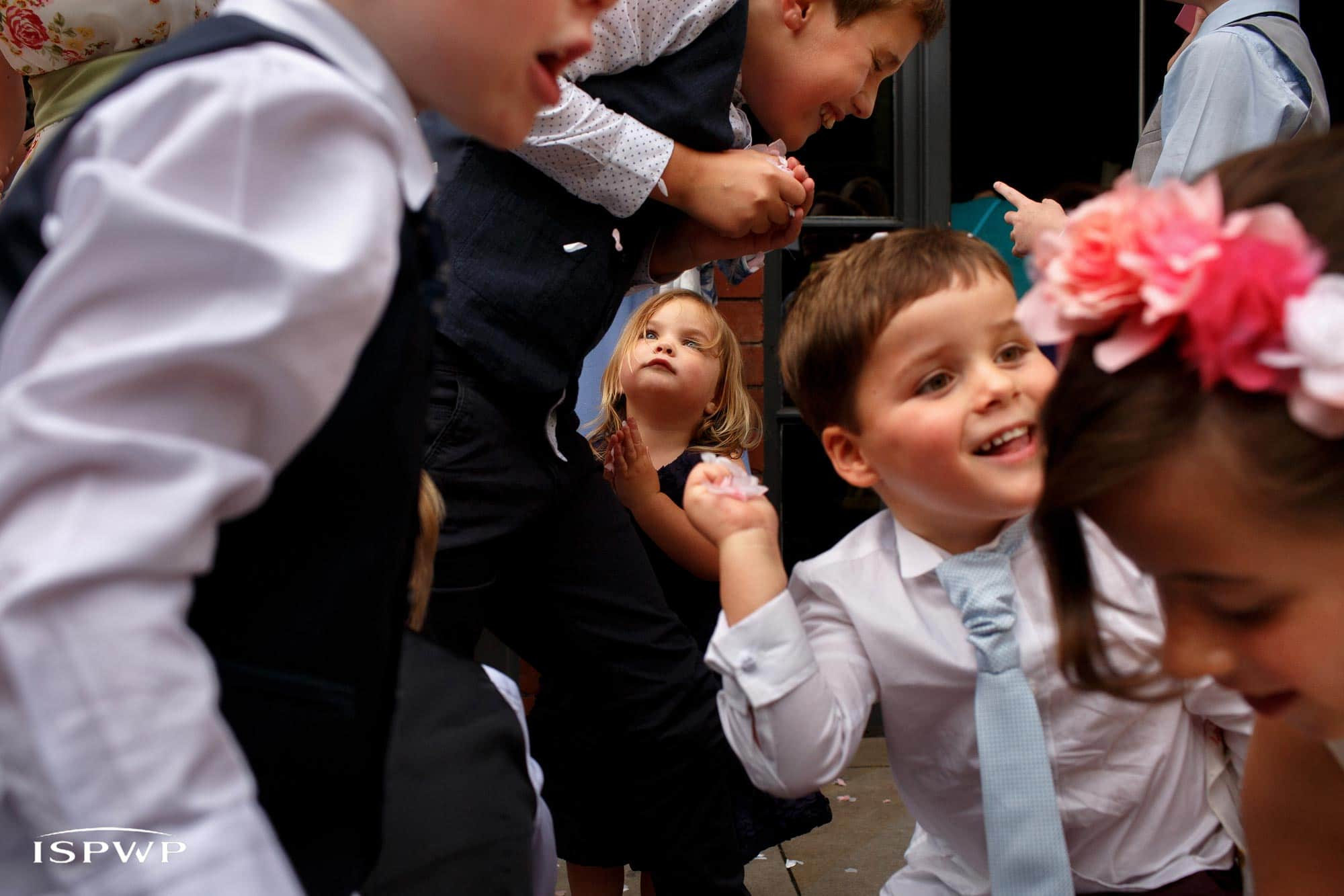 Award winning wedding photograph of children playing with confetti at great john street wedding
