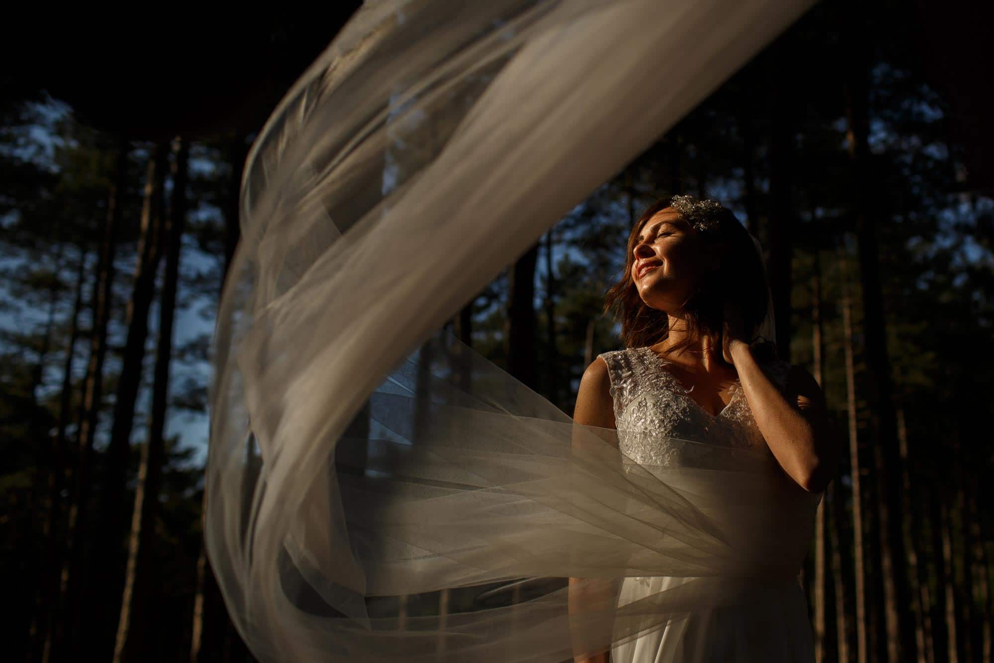 Bride in direct sunlight with flowing veil