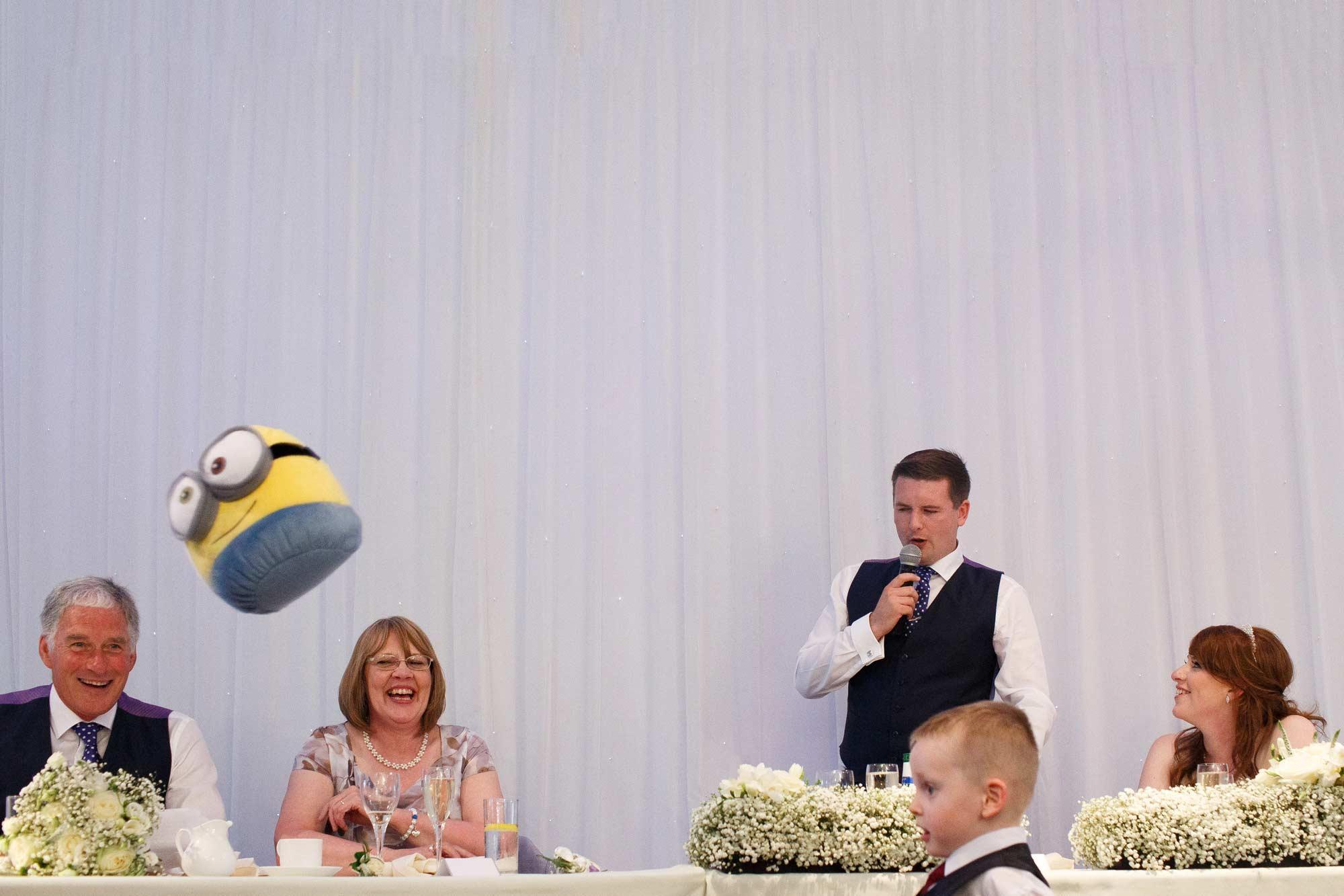 Minion flying through the air during speeches at Heaton House Farm Wedding