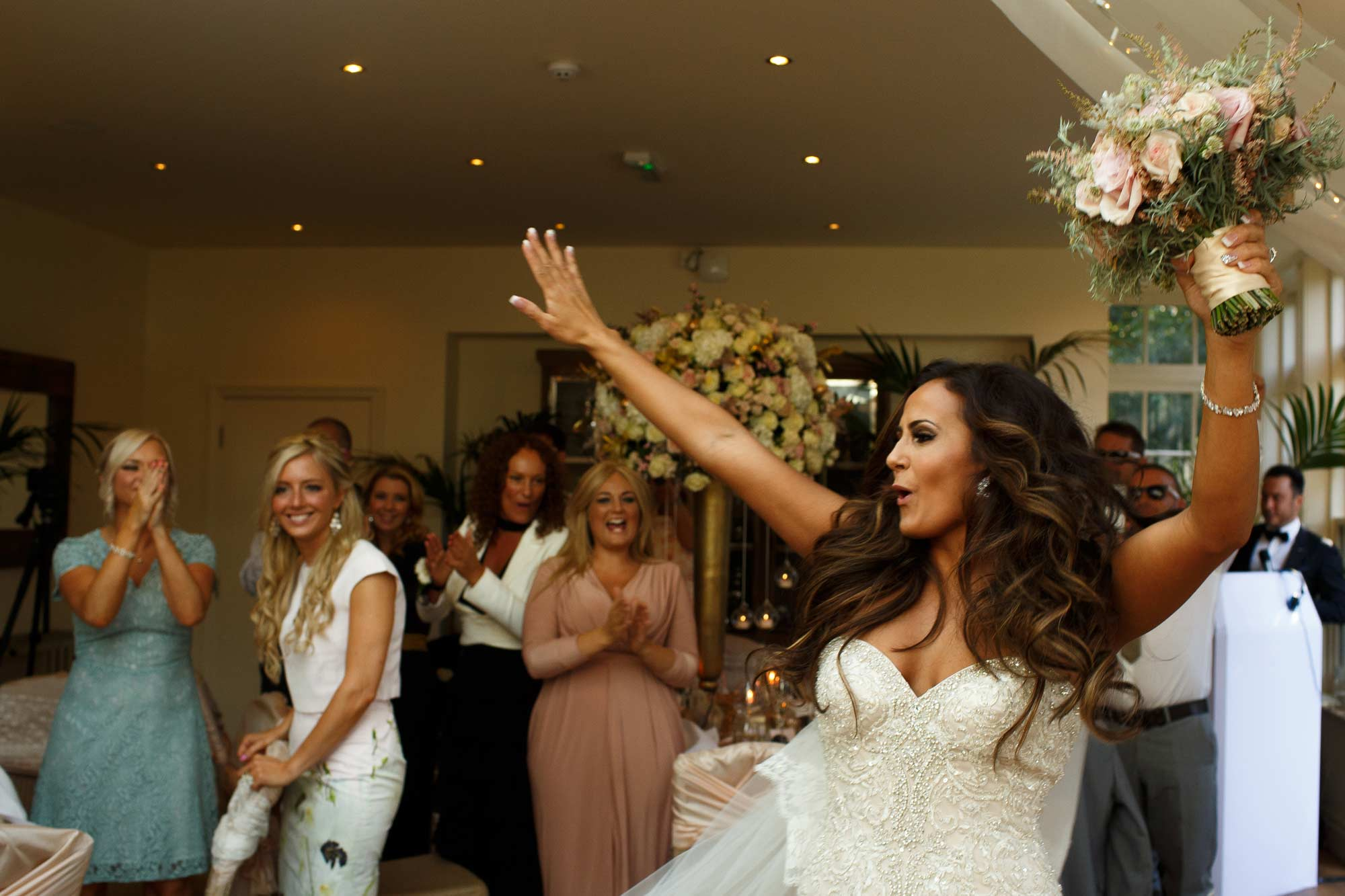 Bride partying as she enters the room at Mitton Hall Wedding