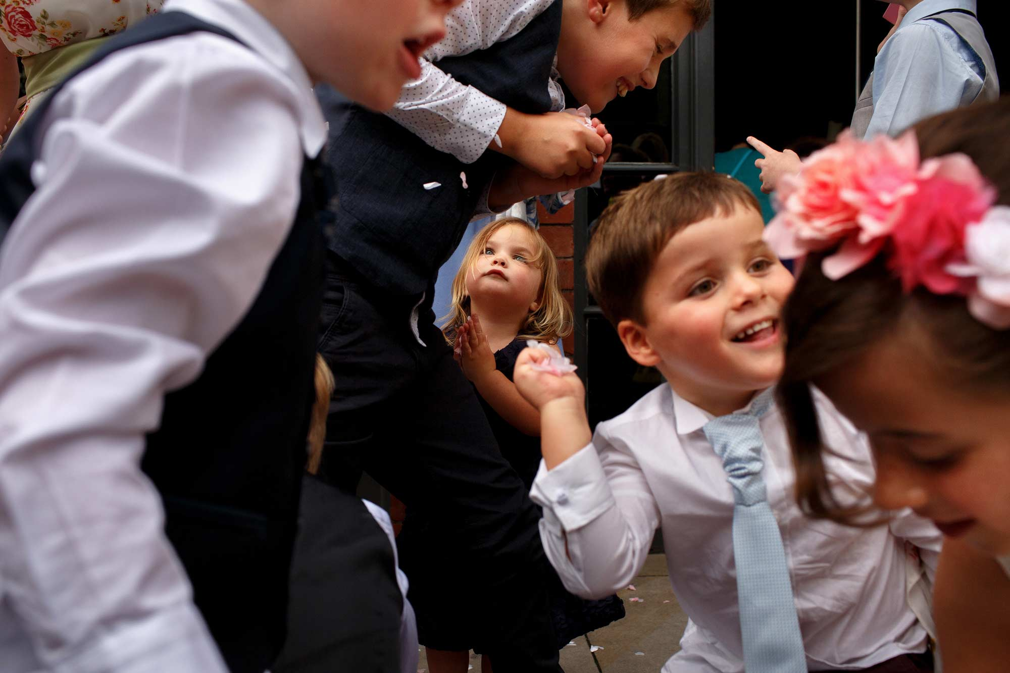 Children having a confetti fight during a wedding at Great John Street Hotel