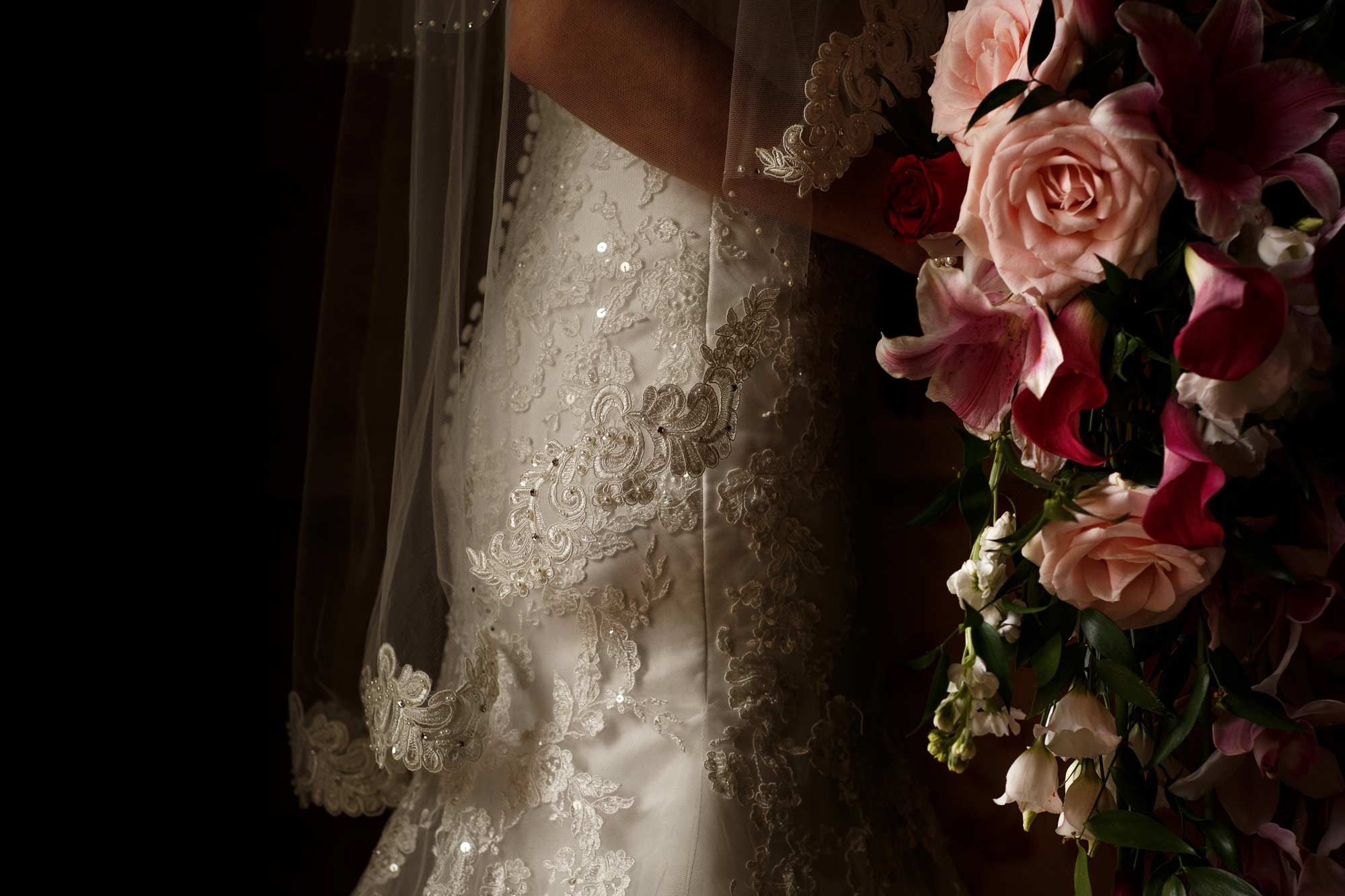fine art portrait of the brides veil and flowers as she is about to walk into her ceremony