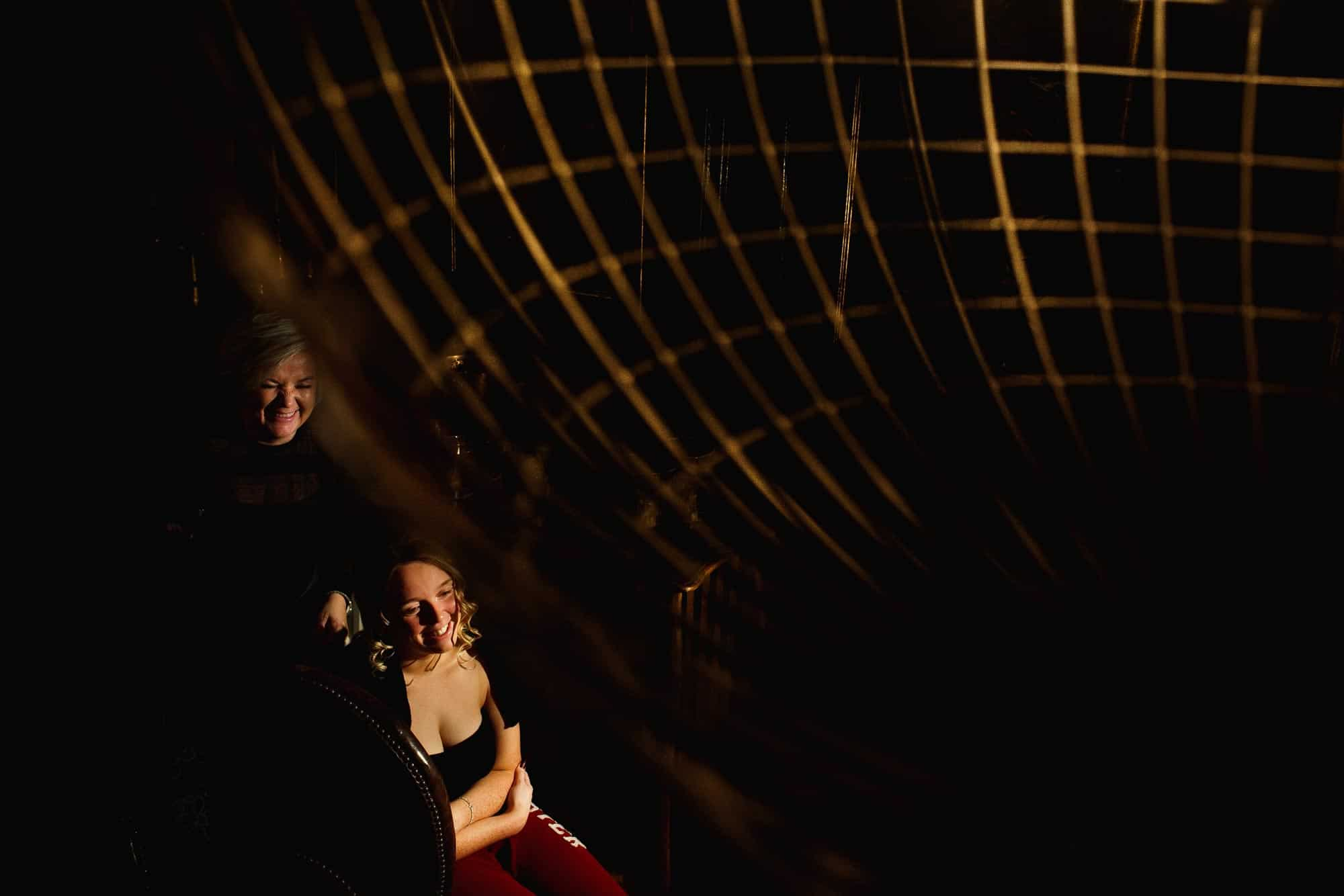 off camera flash abstract wedding photograph of bride getting ready at Mitton Hall