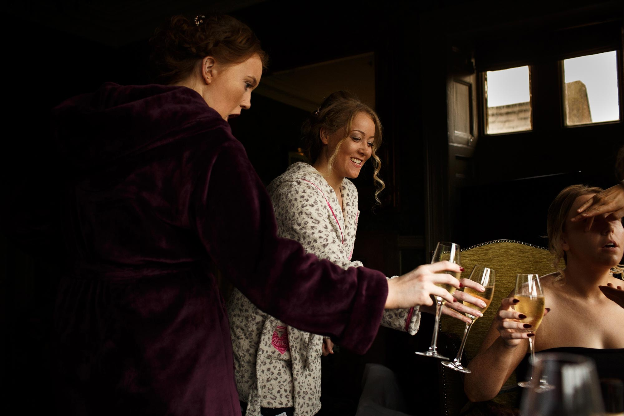 Bridesmaids drinking champagne in the Bridal suite at Mitton Hall