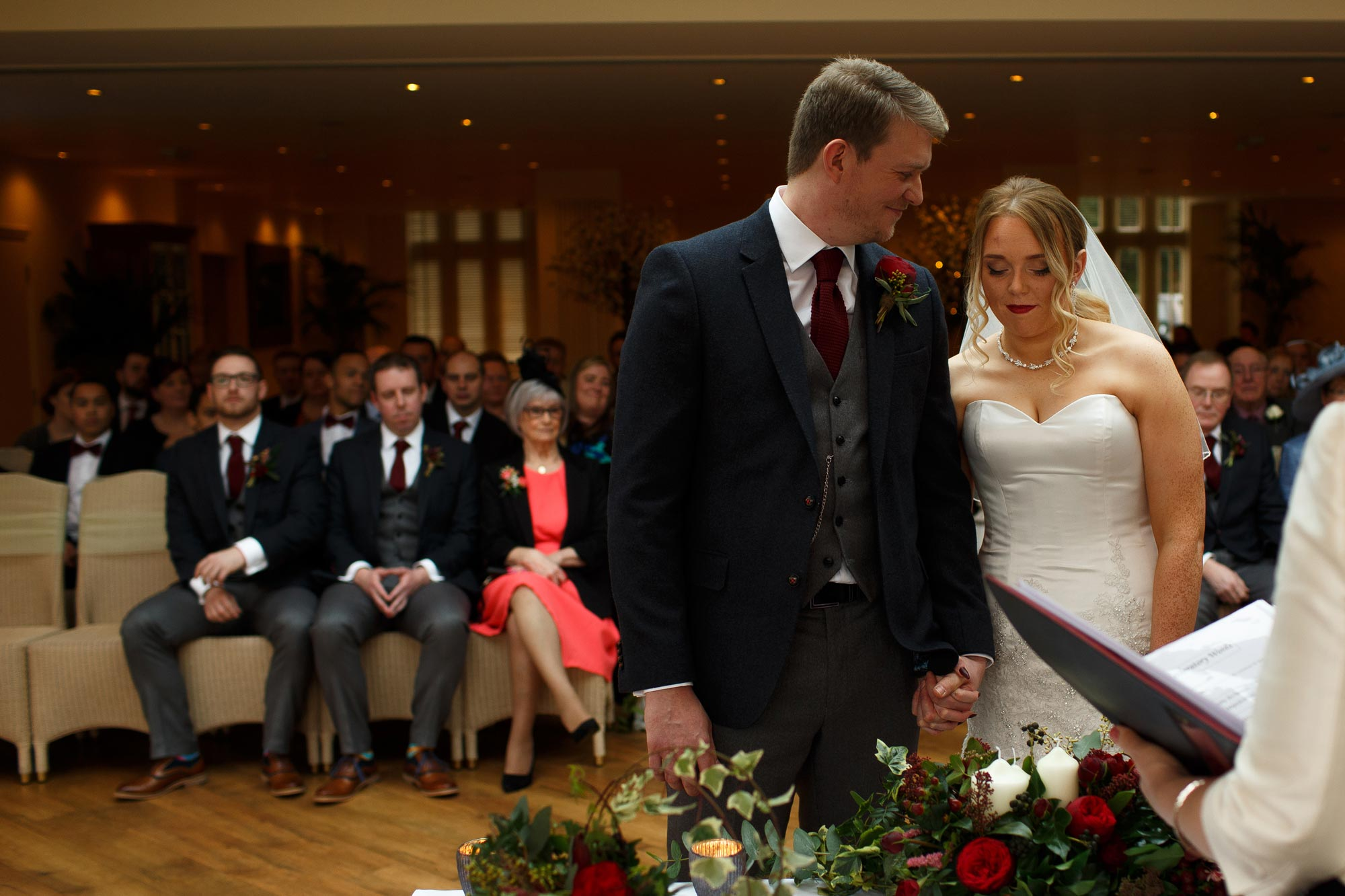 Bride and Groom taking a moment at the top of the aisle inside Mitton Hall