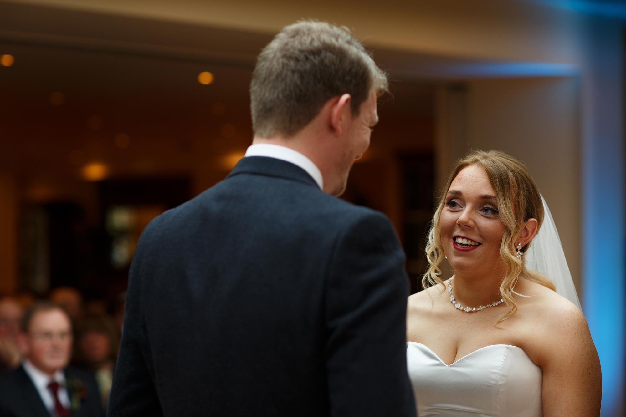 Close up of the Bride and Groom saying their vows inside the conservatory at Mitton Hall
