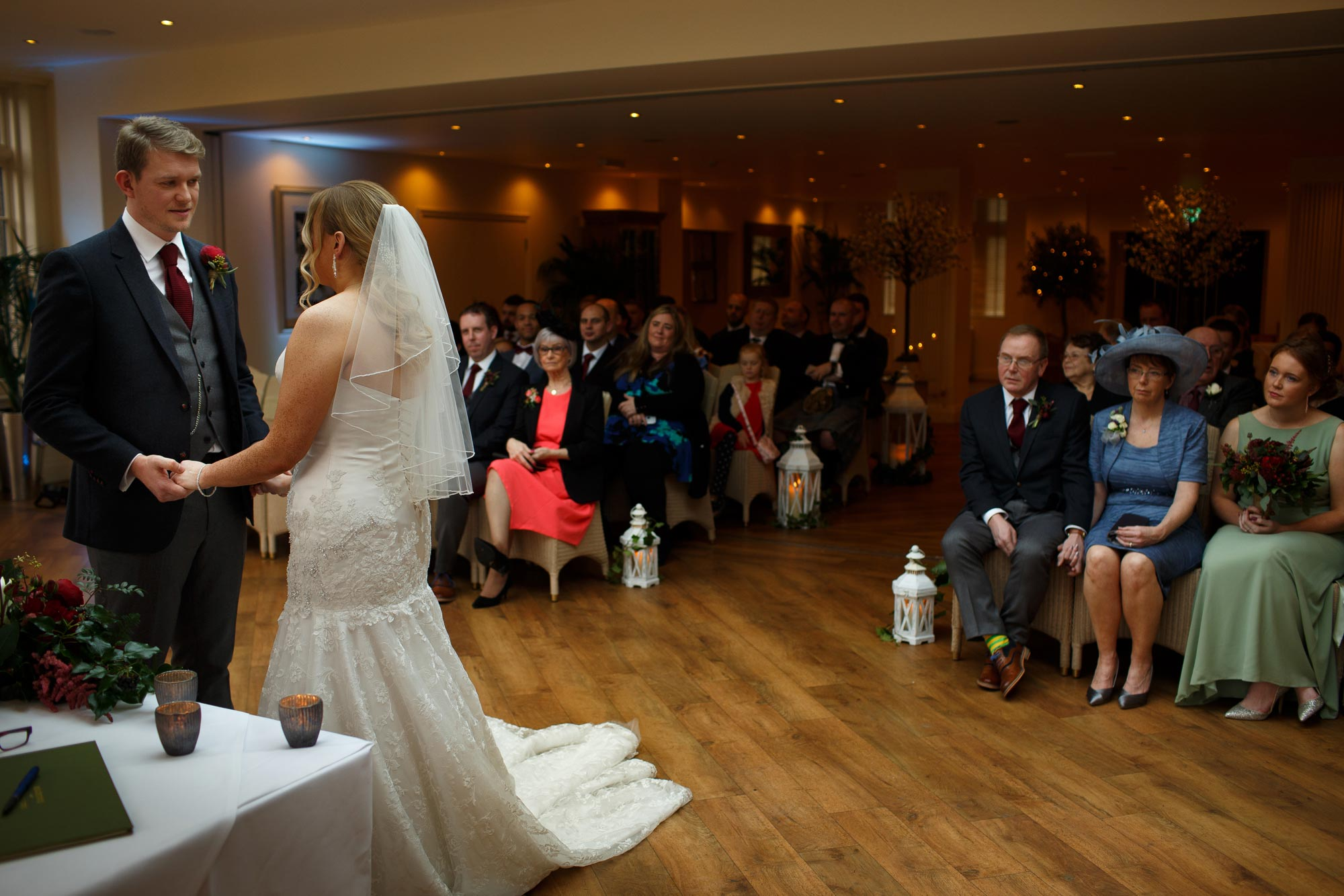 Wide angle of the Bride and Groom saying their vows inside the conservatory at Mitton Hall