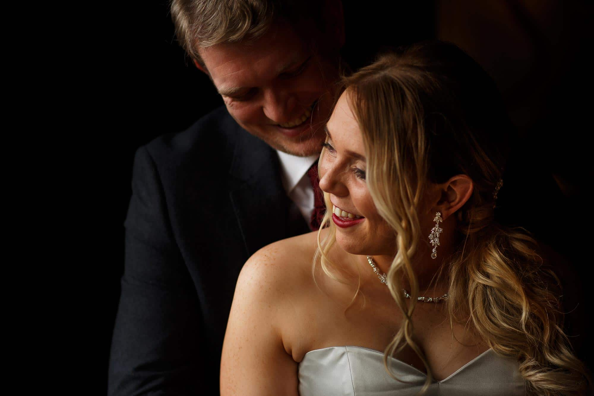 Cropped photograph of bride and groom portrait inside Mitton Hall