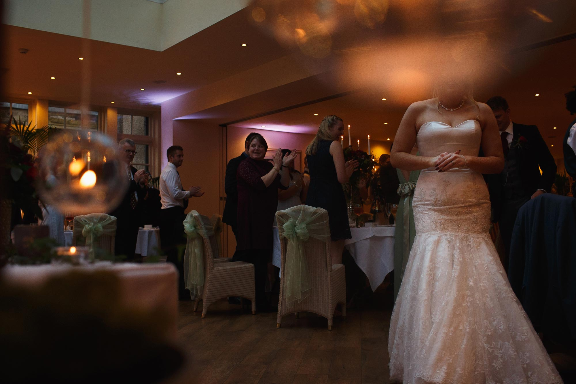 Abstract wedding photograph of the bride and groom walking into their wedding reception at Mitton Hall