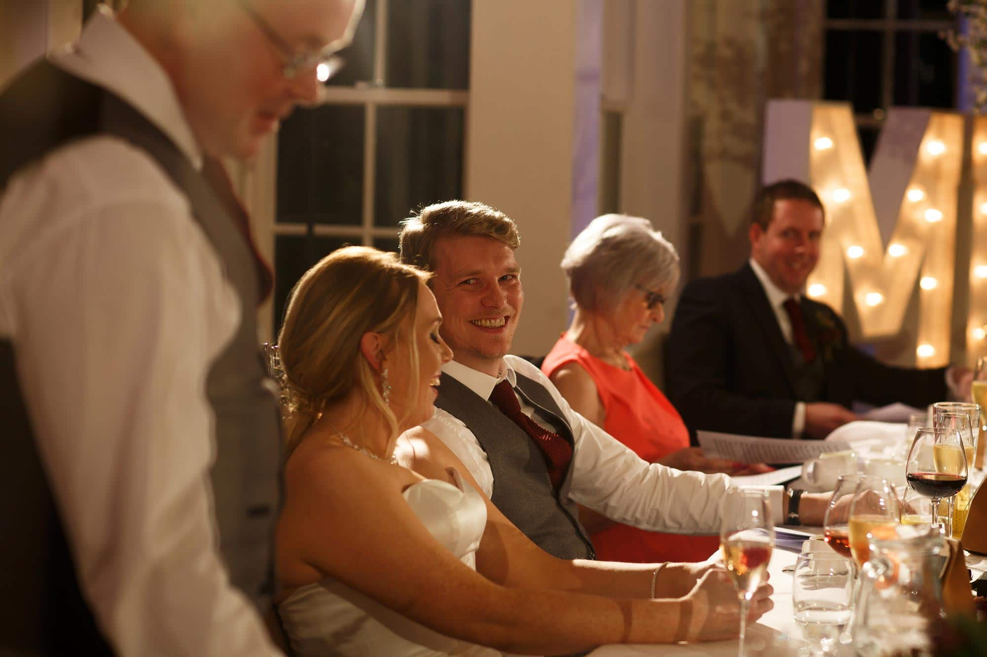 Groom looking towards the father of the bride during the wedding speeches at Mitton Hall