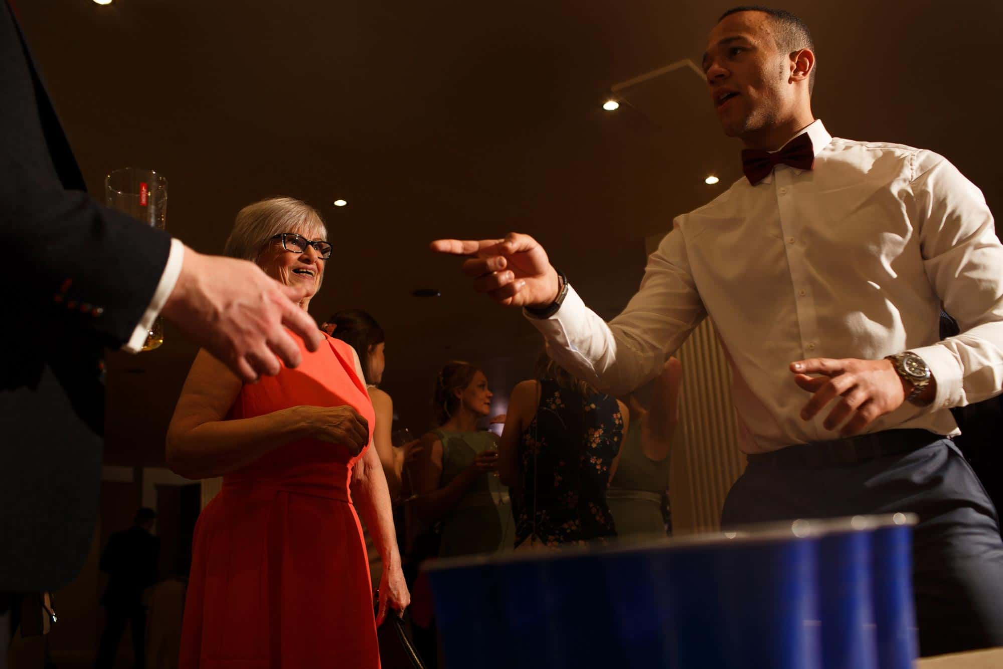 Wedding guests playing beer pong at Mitton Hall wedding