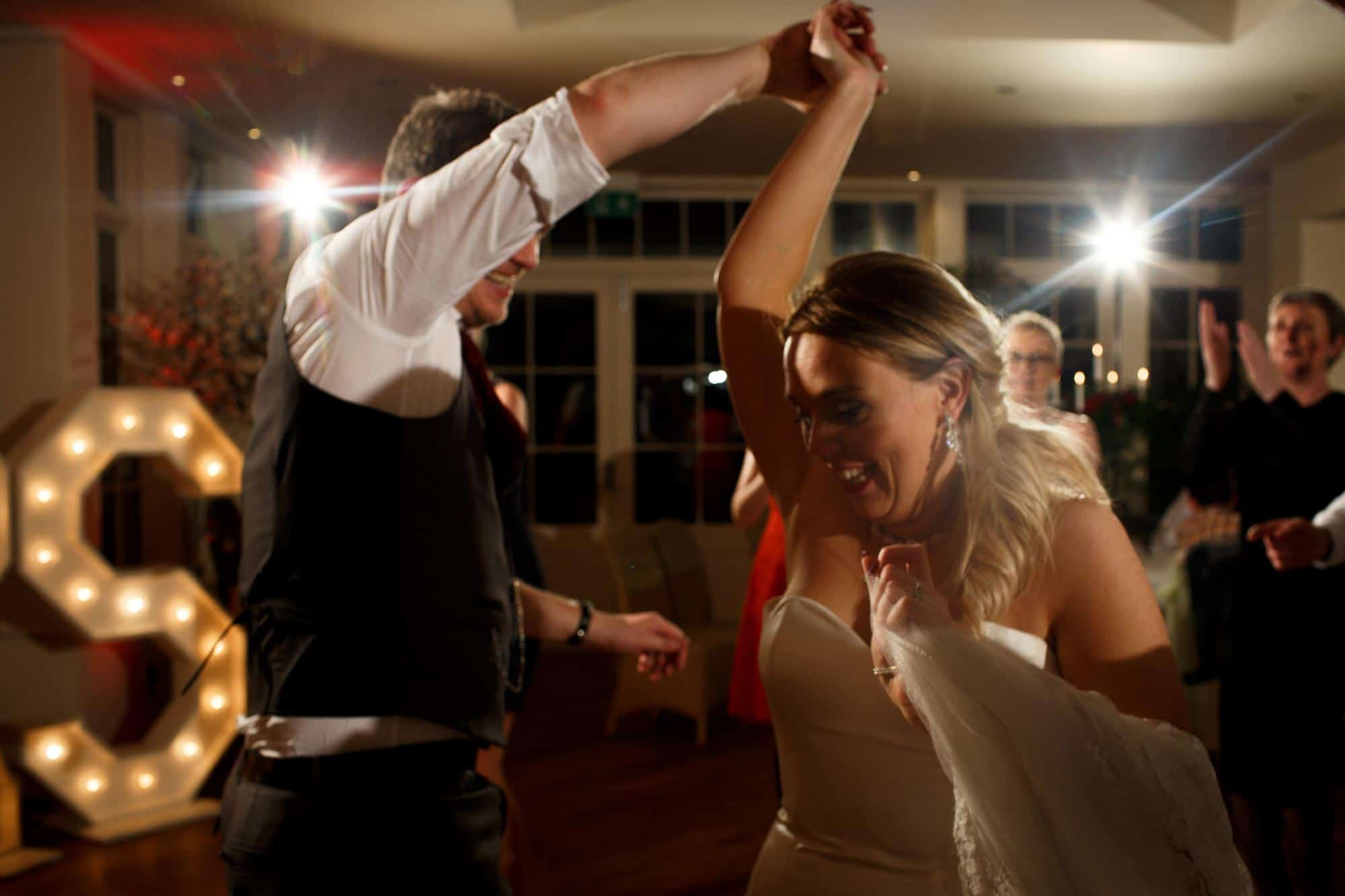 Bride and groom dancing at Mitton Hall wedding