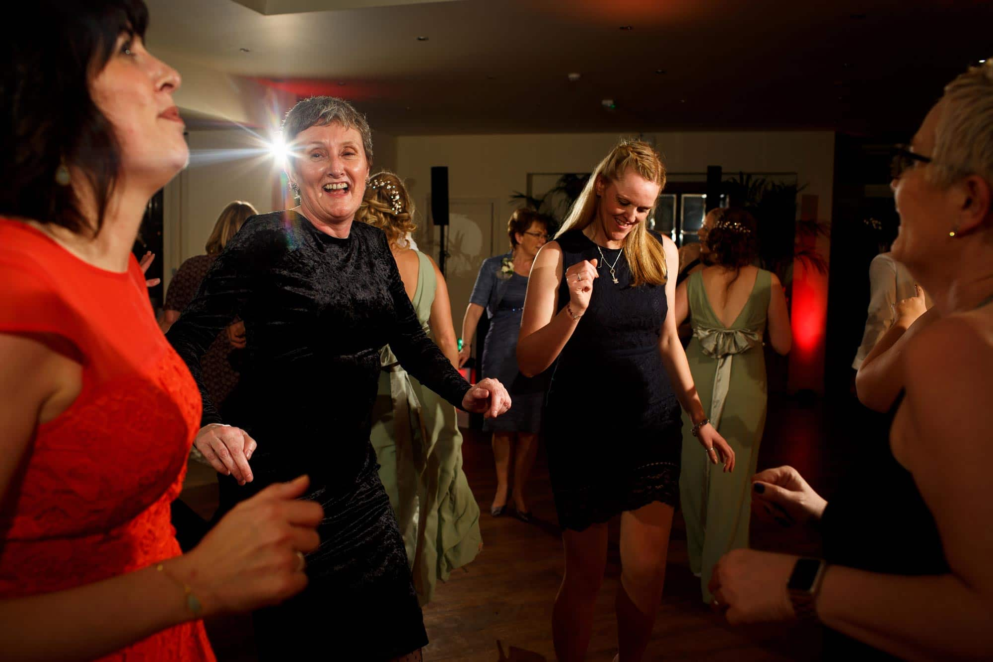 Wedding guests dancing at Mitton Hall wedding