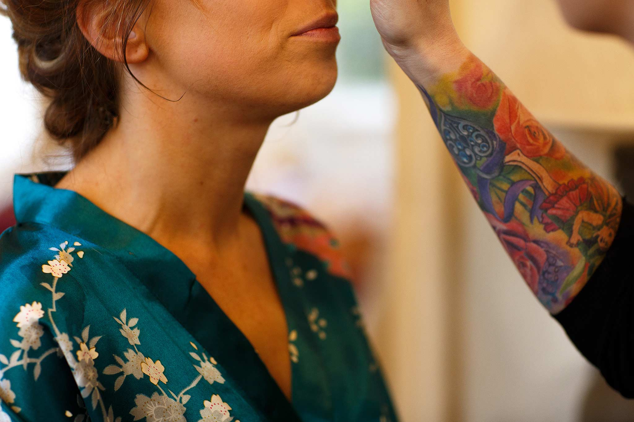 Make up being applied by make up artist with tattoo at Samlesbury Hall
