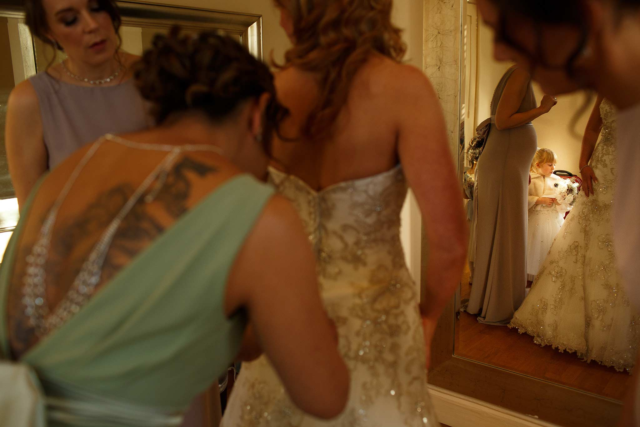 Bride getting into her dress at Samlesbury Hall