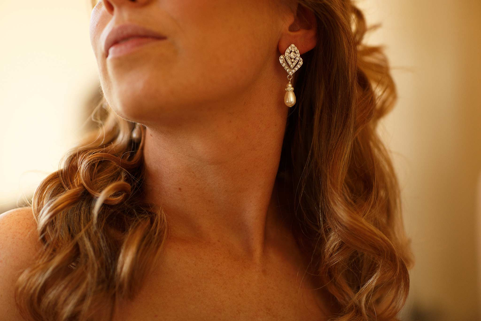 Detailed photograph of brides earrings at Samlesbury Hall